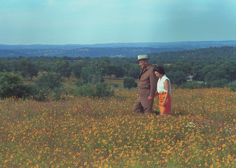 President Lyndon B. Johnson and Lady Bird Johnson walking through a field of flowers.LBJ Library photo by Frank Wolfe.