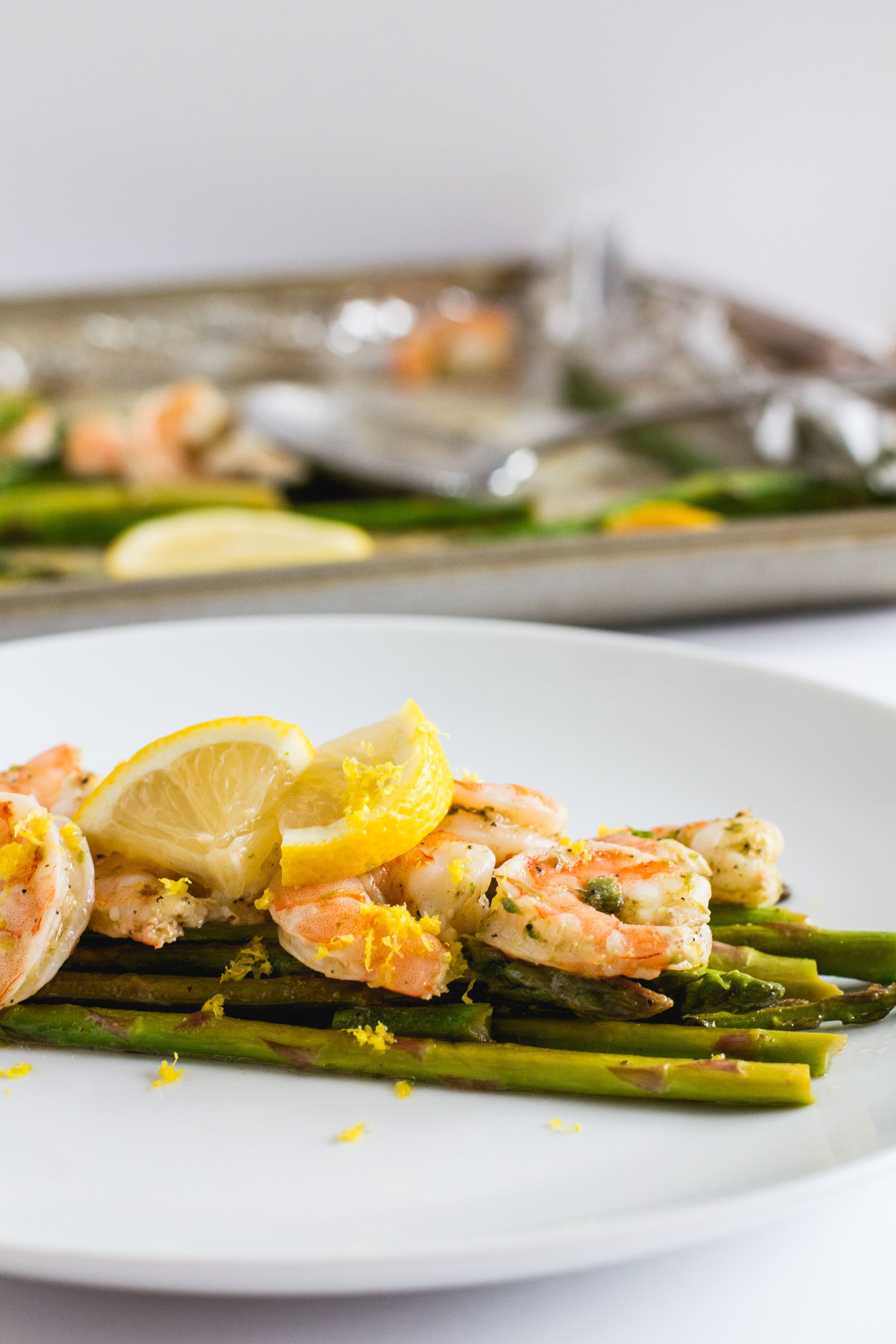One Pan Roasted Shrimp + Asparagus — This super easy weeknight meal is gluten-free, dairy-free, whole30, and keto-friendly! Get the recipe at sarahjhauser.com! | Sarah J. Hauser #glutenfreerecipes #lowcarbmeals #whole30dinner