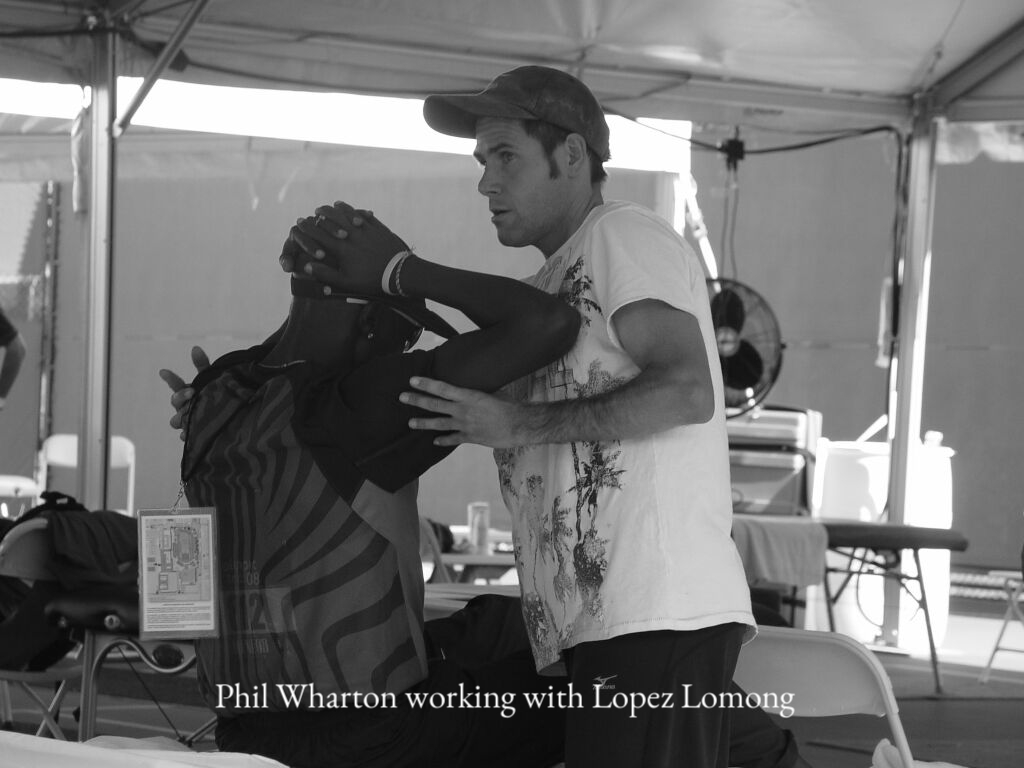 Phil Wharton with Lopez Lomong