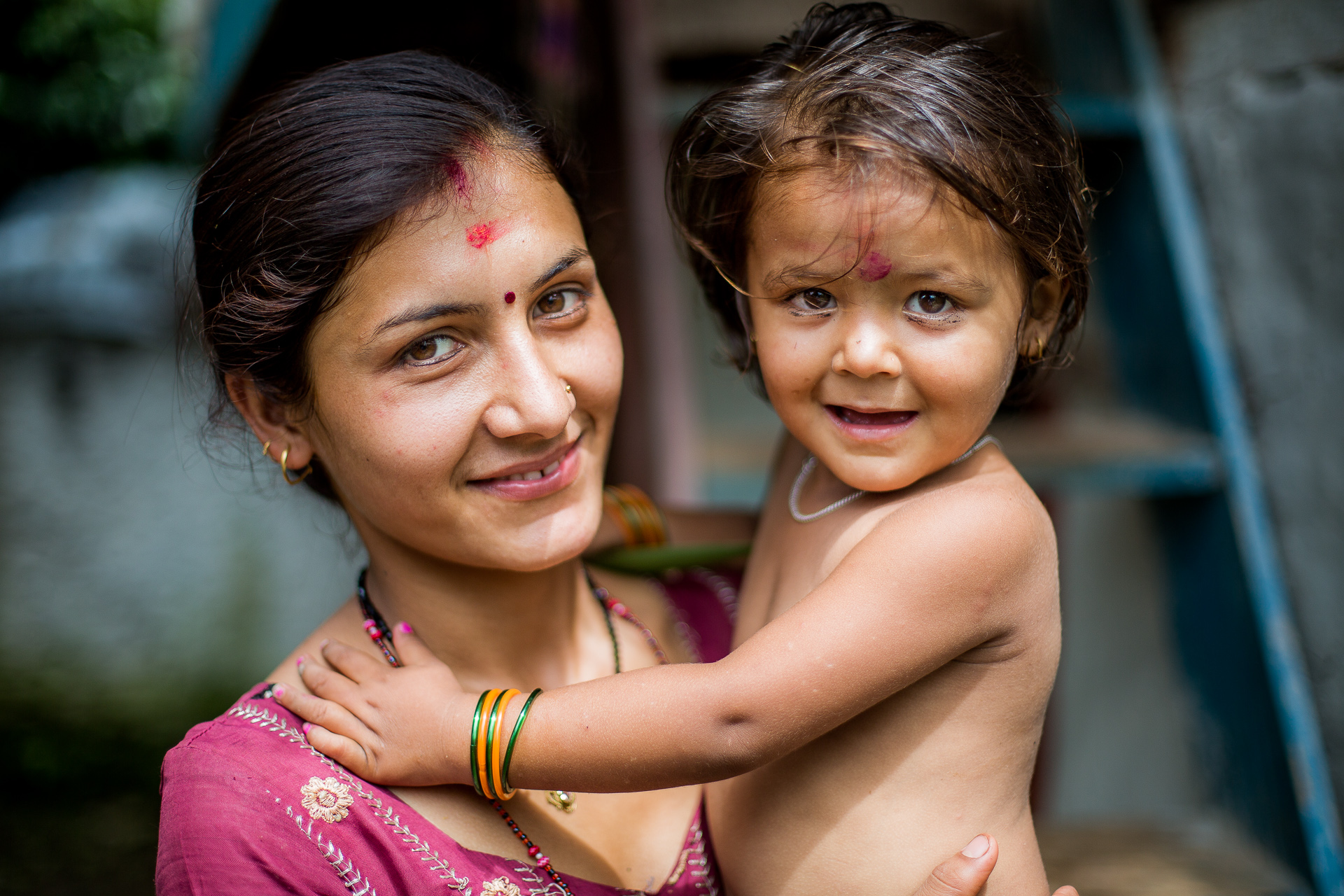 Caring mother proudly posing with her child. She was one of Rohit's neighbours when he was living in this remote mountain village.