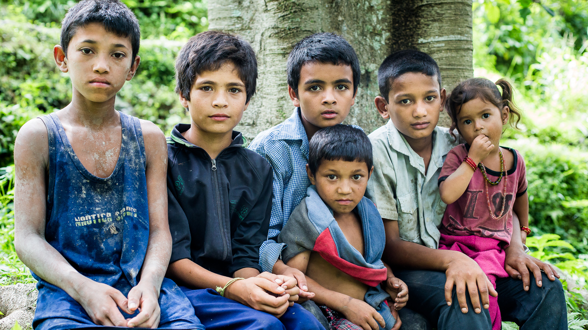 Children posing close to the fields where they were working with their parents.