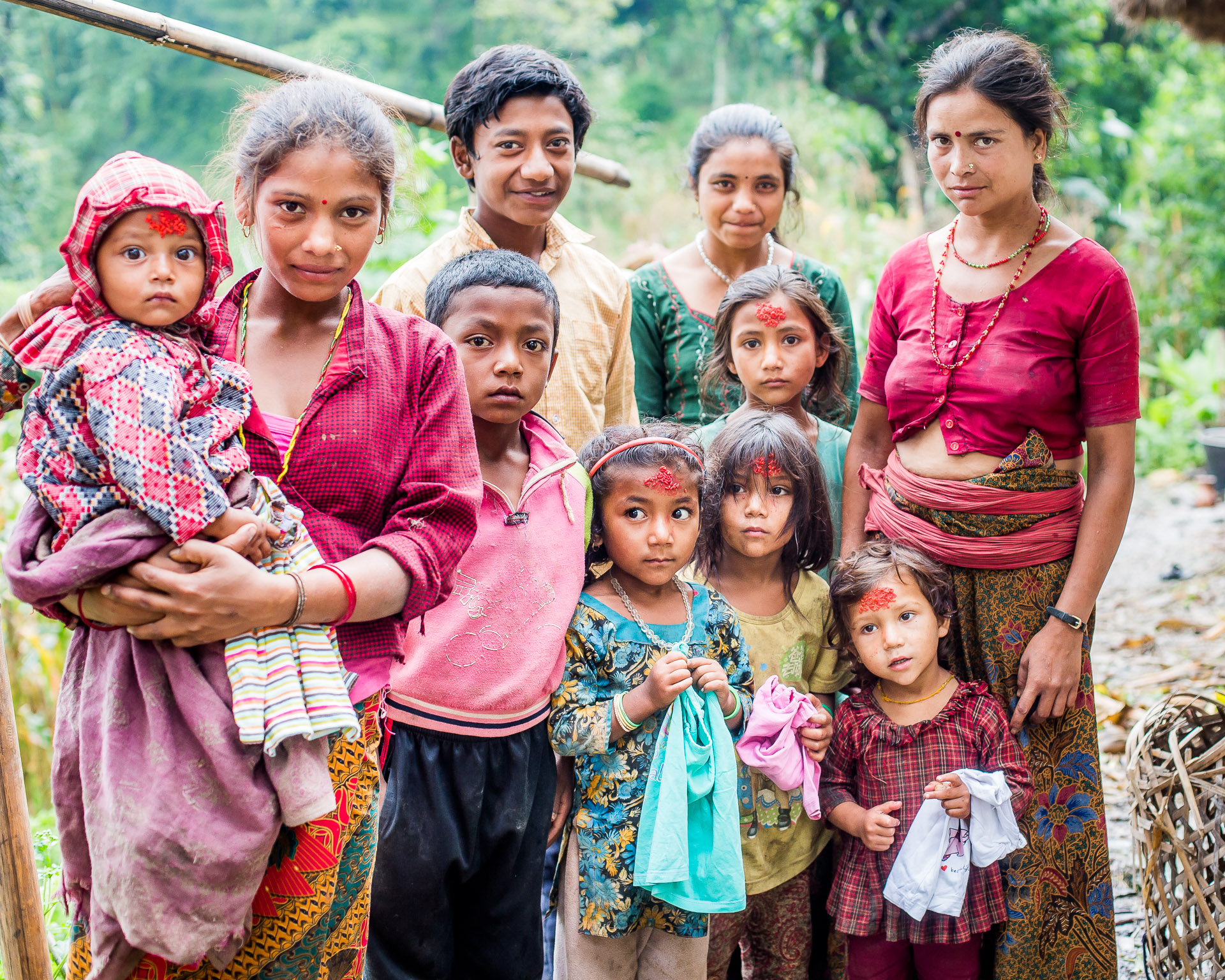 Two families: Micro-Care Nepal was able to give clothing to almost all these children.