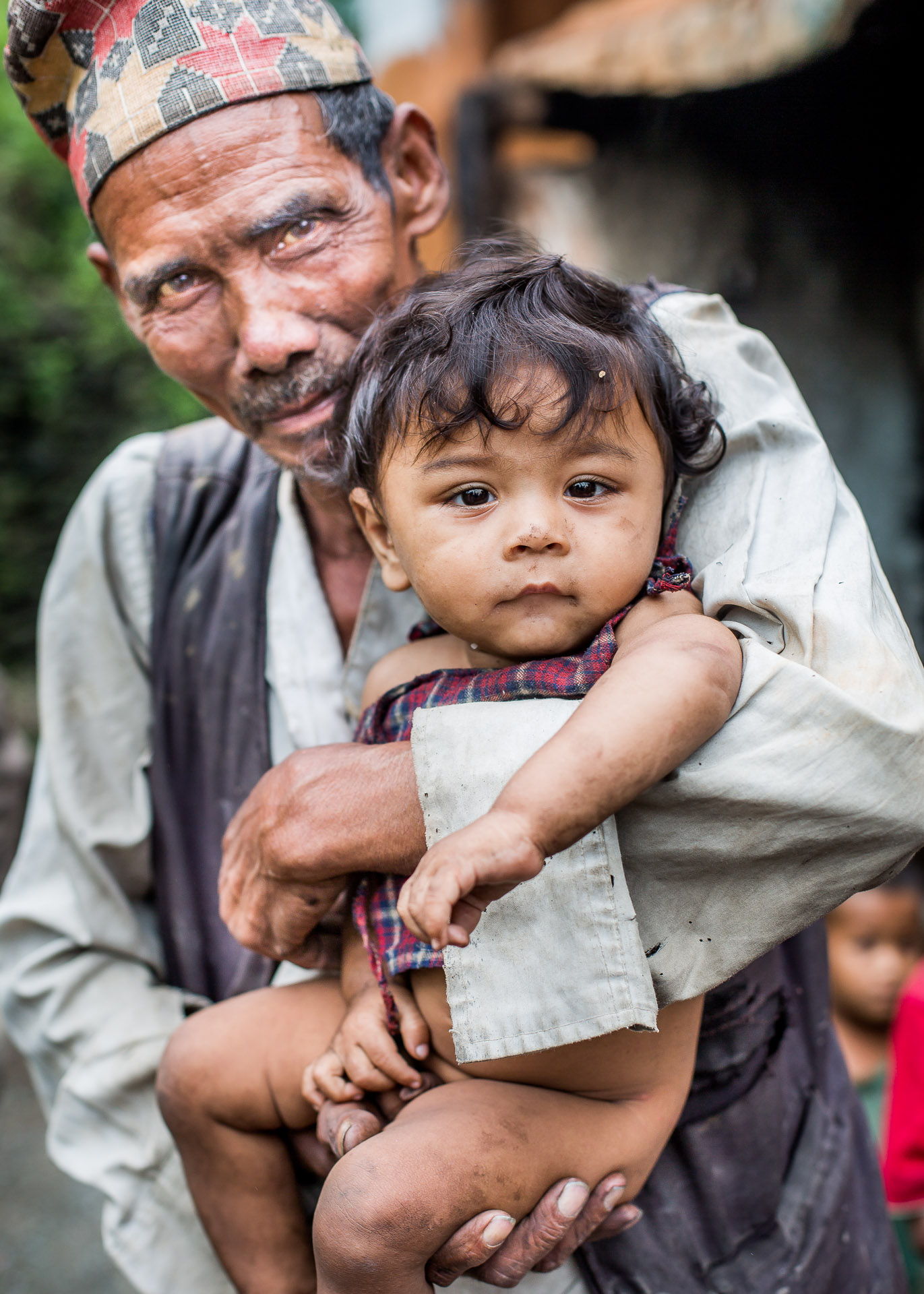 Father showing his son's damaged clothing. I think these families are the really worthy recipients of Micro-Care Nepal's clothing.