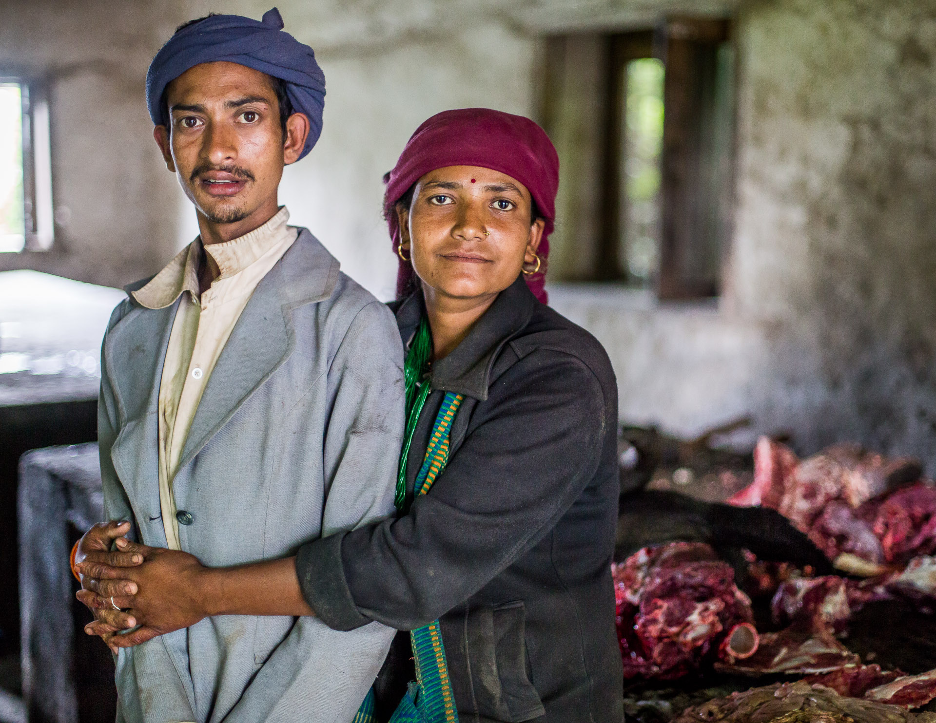 This husband and wife work every Thursday, butchering animals that are sold in the market.