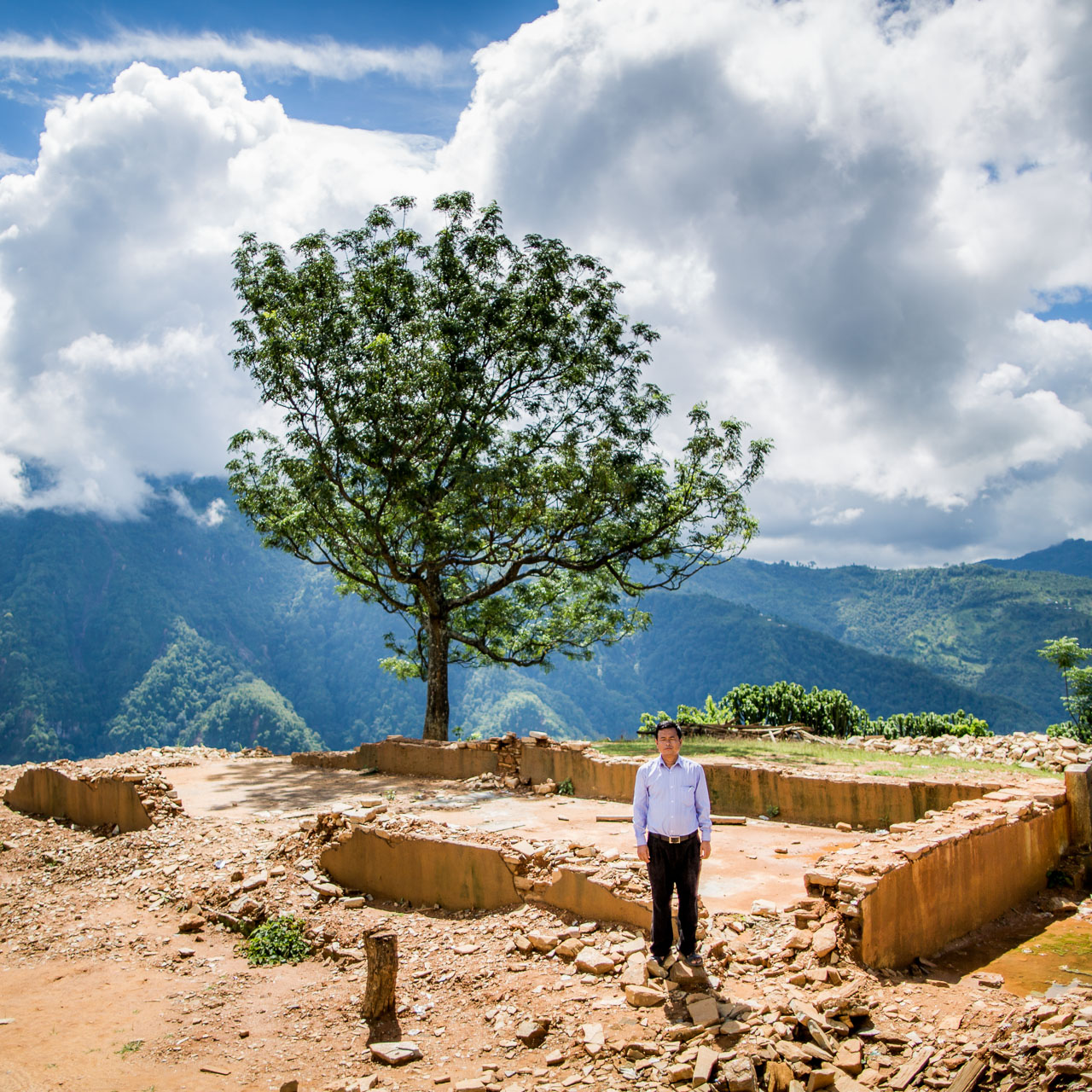 The principal of the ShreeHimalayaHigher Secondary School standing amongst all that remains of their oncebeautiful school building.