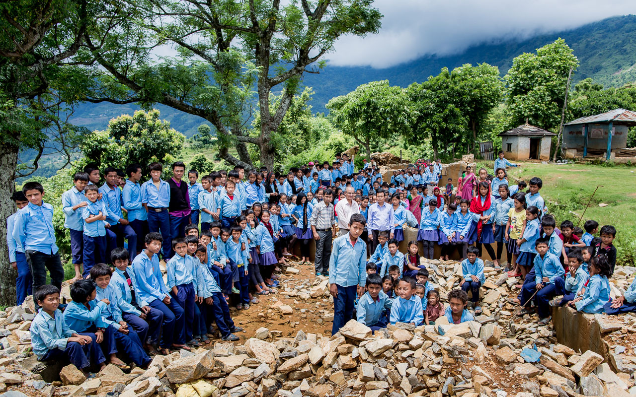 All the students amongst the ruins of their school.
