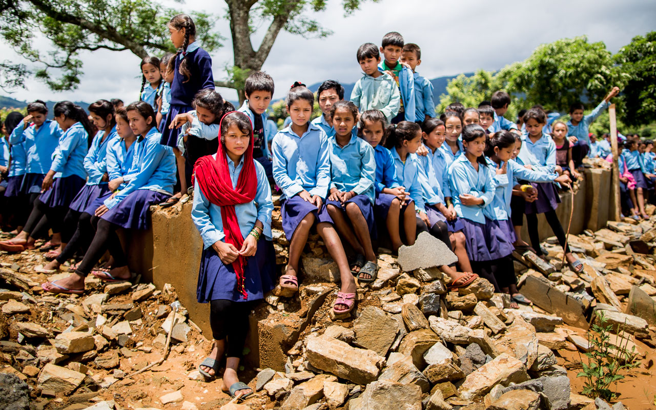 Children in the remains of their classrooms.