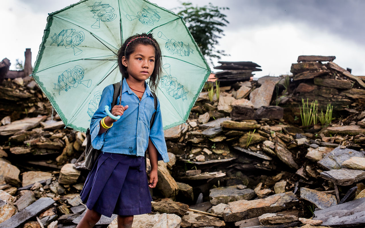 Child passing all thatremains of her house every morning going to school and every afternoon returning home. The look on herface shows her feelings…