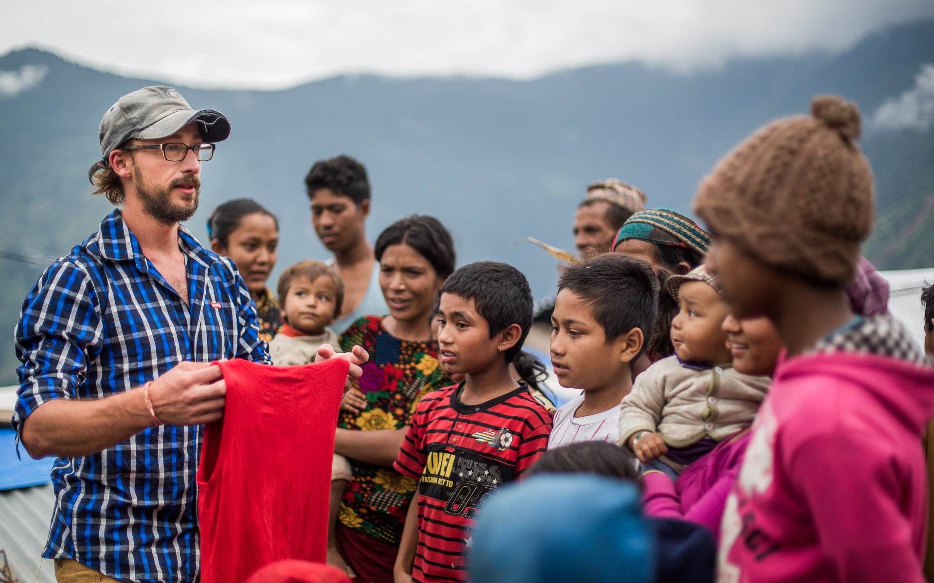 Handing over clothing to a surprised group of Dalit (Untouchable) people in Barpak.