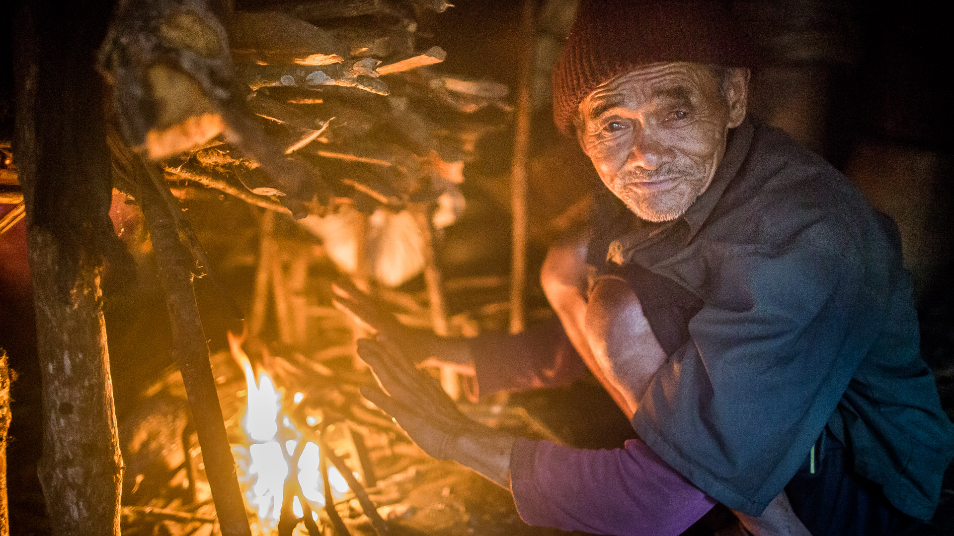 Because Laprak is at 2300 meter about sea level it can get cold in evening. They warm themselves at their fires.