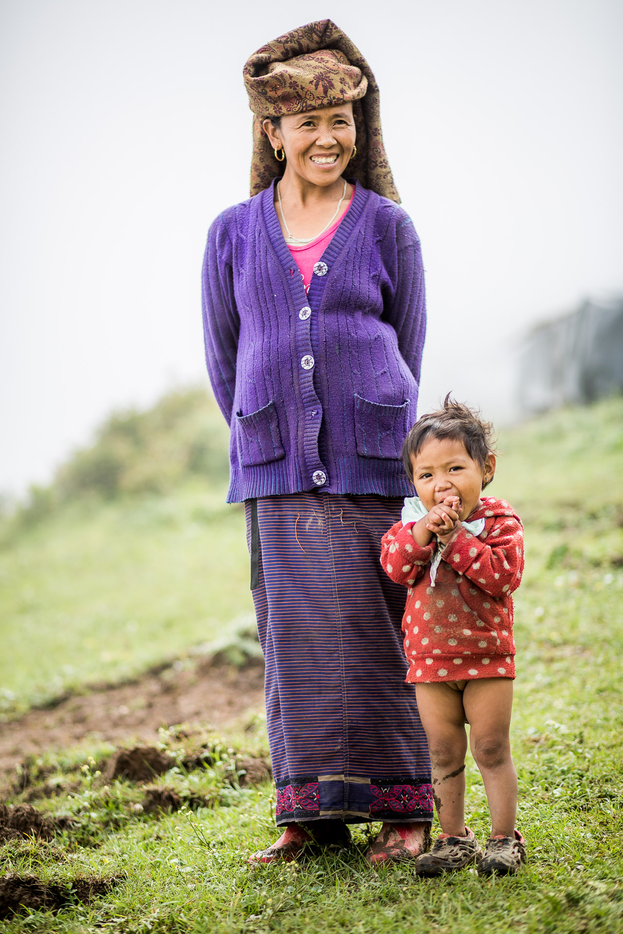 Mother with her daughter looking over the valley.