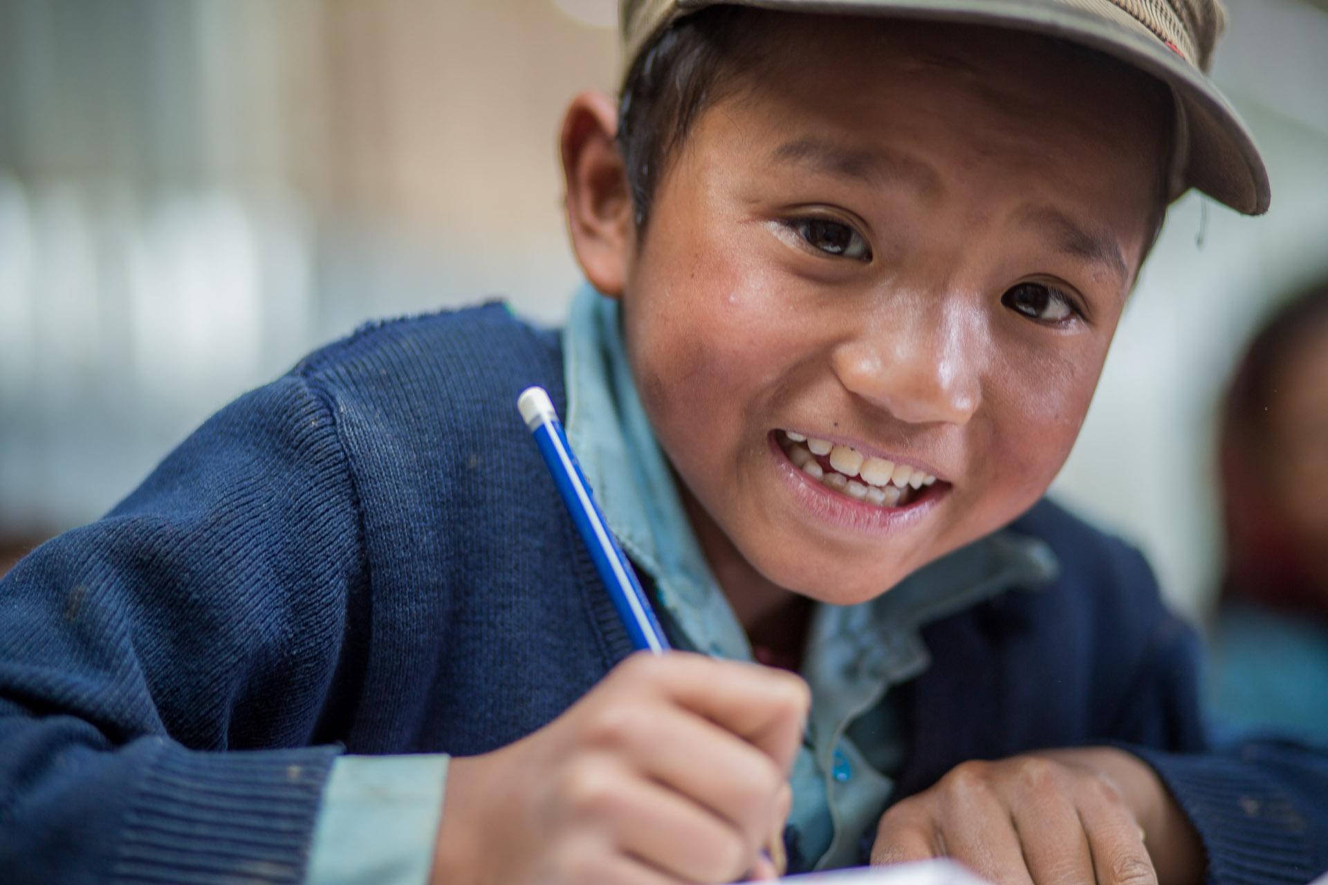 Boy writing his schoolwork.