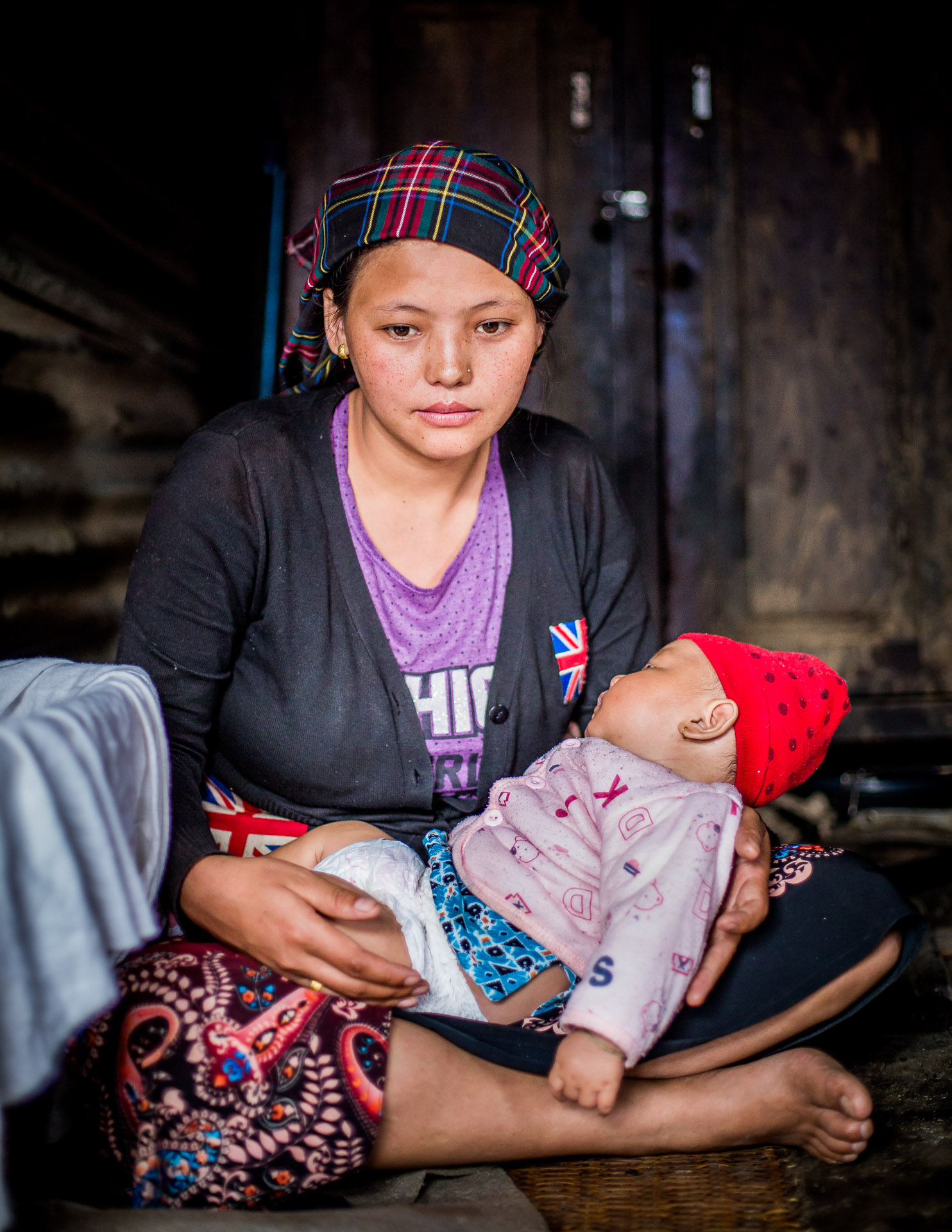 Mother who was pregnant during the eathquake who lost her 25 year old husband. Now she is left alone with her 3 months old boy..