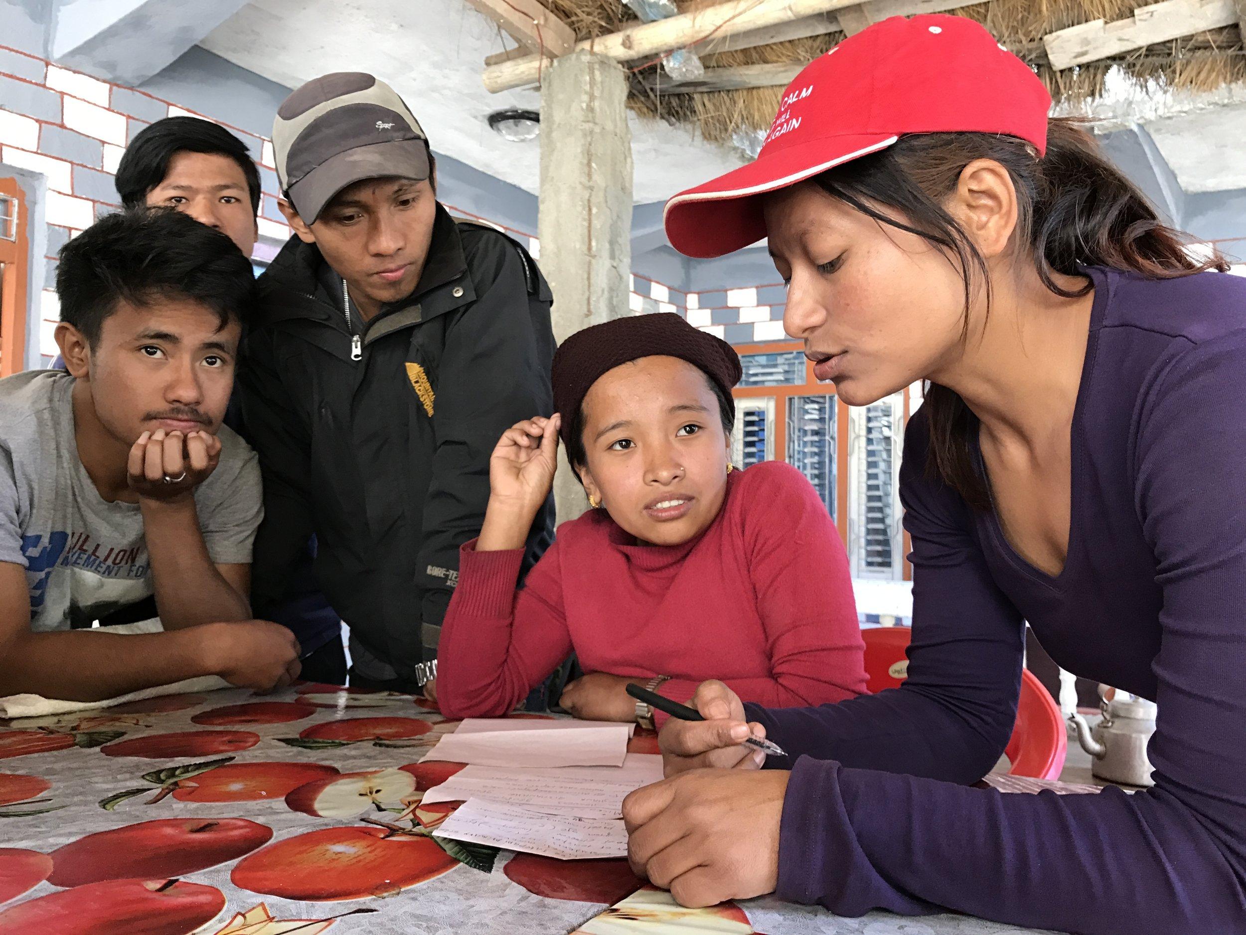 Samjhana explaining about our school materials at Korla Besi.