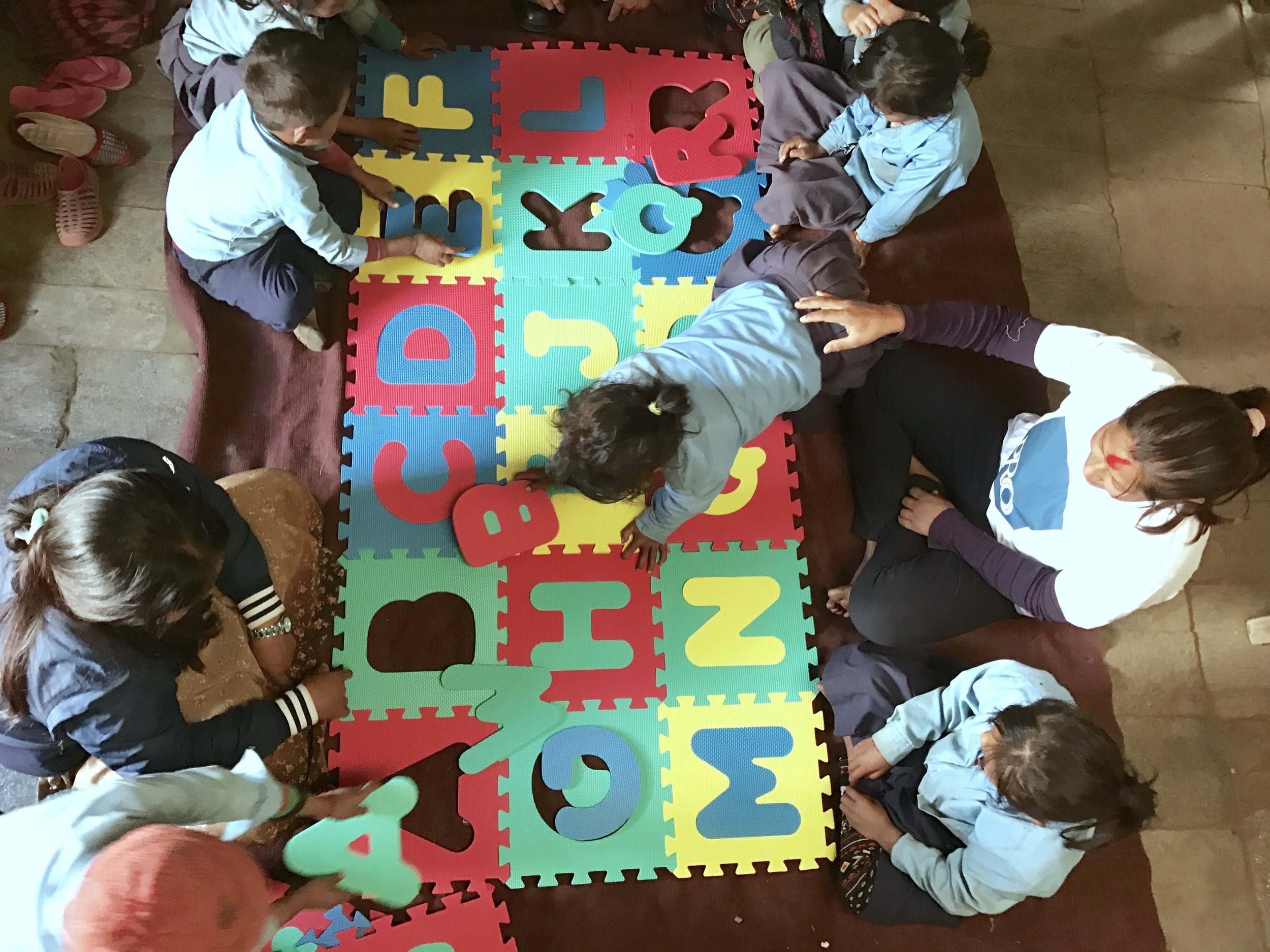 Alphabet group puzzle for the playgroup children of Uhiya in Gorkha district.