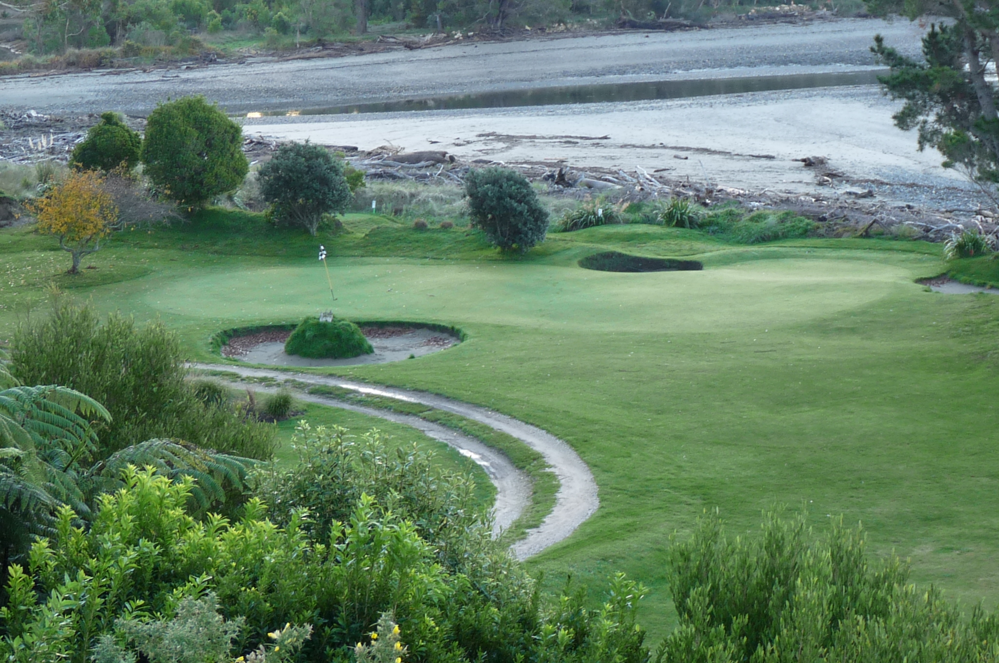 View of mostly hidden green - tee is from lower left, at right angles to the green
