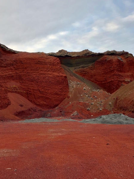 Red lava rock in Iceland. Yes it is really red. Lately it's being used to make roads. Red roads.