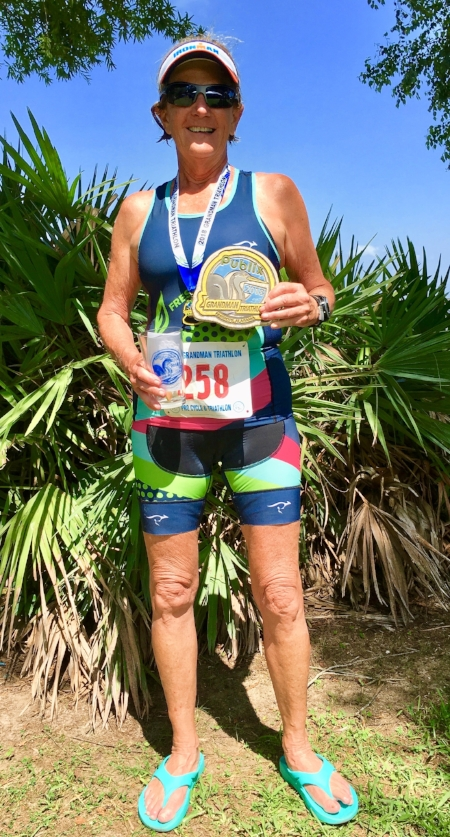 Gini came in first in her age group at the Grandman Triathlon on Saturday, June 2, in Fairhope, Alabama, her second race since Bill's death. The triathlon event comprised a 1/3-mile swim in Mobile Bay, an 18.6-mile bike, and a 3.1-mile run.