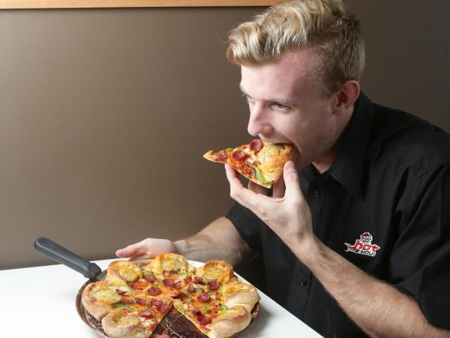 Australian's love their pizza, with Dominos and Pizza Hut gobbling up majority of the fast food pizza market. Picture: Jono Searle. Source: News Corp Australia