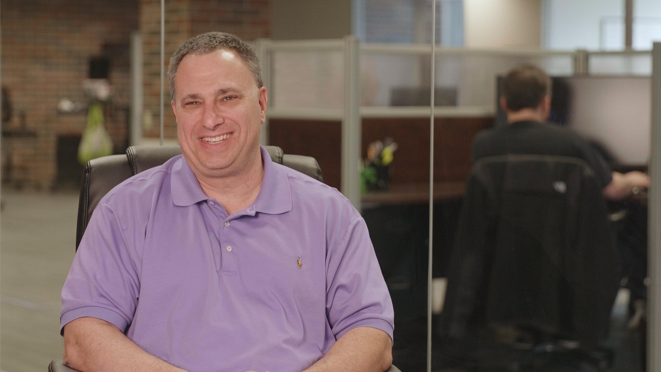 Dennis Noto at Denver office.jpg