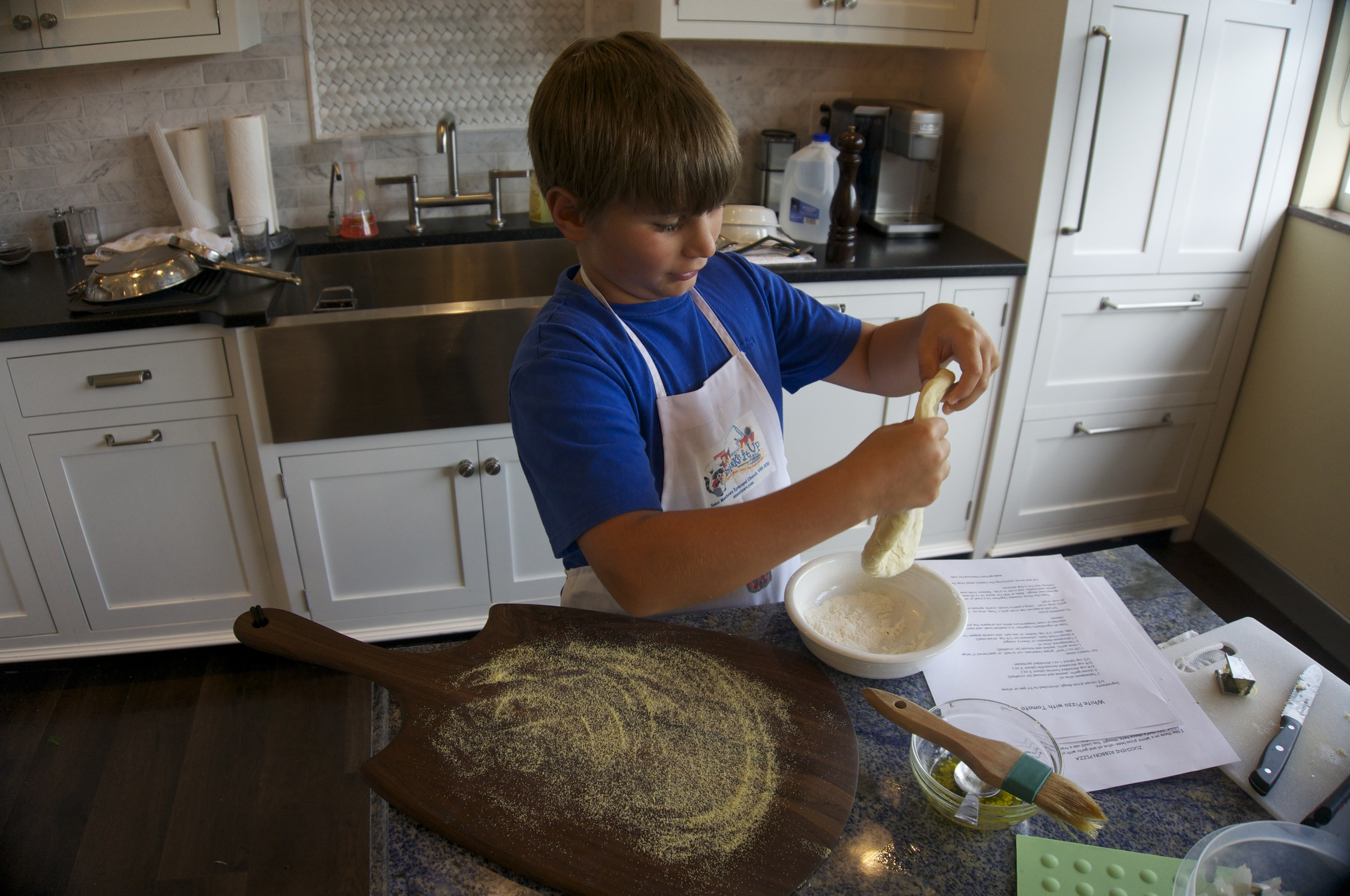 9-year old Isaac stretches the dough