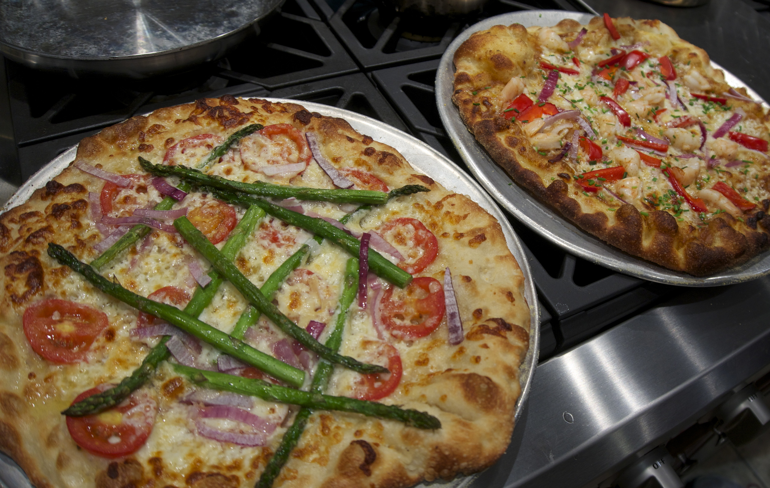 Color is king when it comes to fabulous pizzas -- this one with Roma tomatoes, red onion, and asparagus.