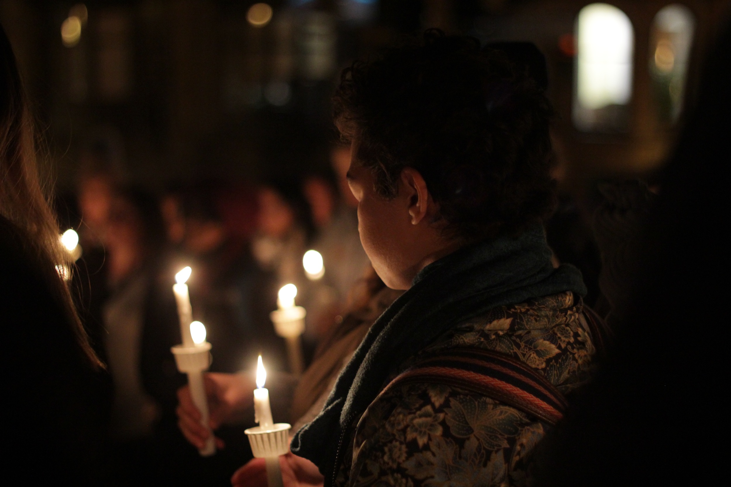 This photo was taken at a  candlelight vigil  responding to the string of terrorist attacks in Paris, Baghdad, Beirut, and several other countries. Photocredit: CJ Ormita