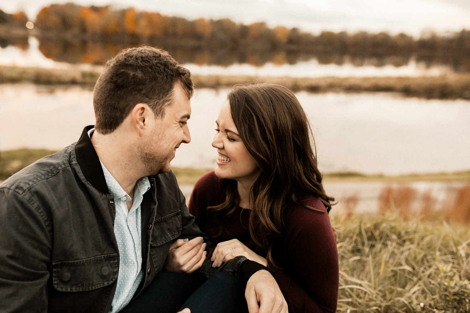 Couple laughing at fall Indiana engagement session