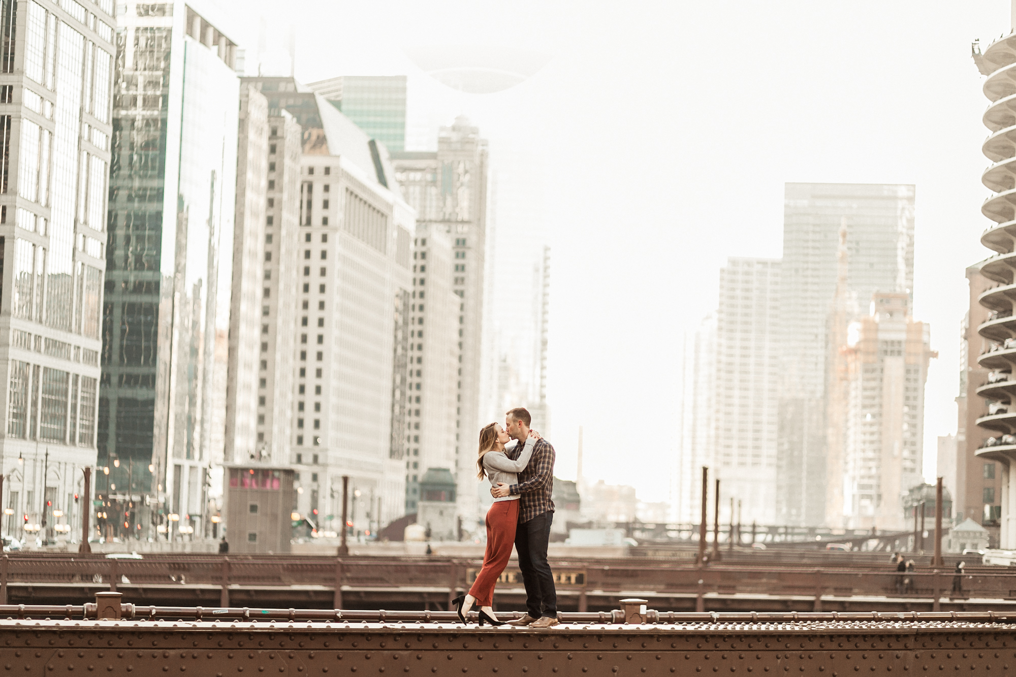 Engagement session on downtown Chicago bridge on State Street