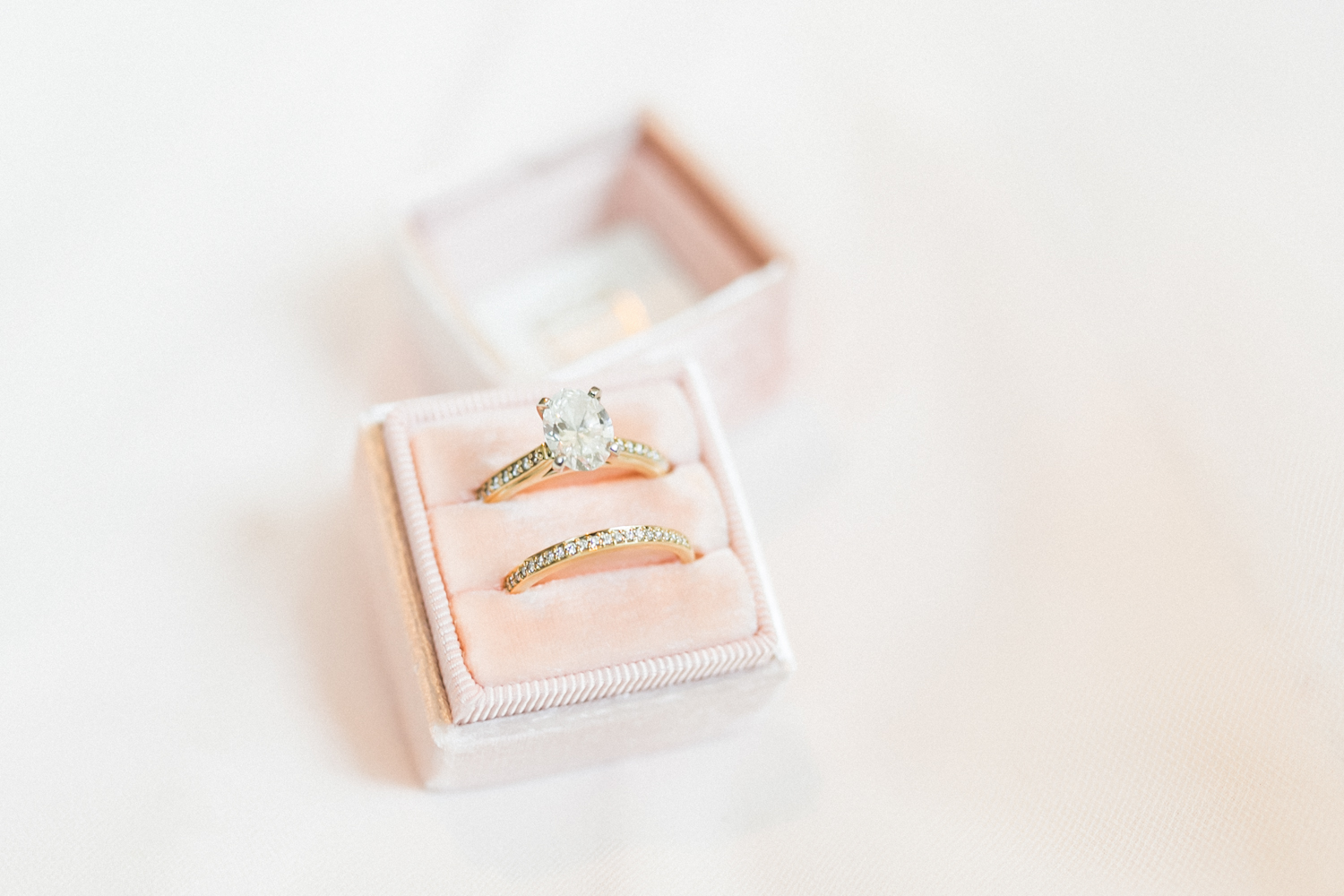 Diamond ring with gold band in a Mrs. Box by photographer Cassie Howard