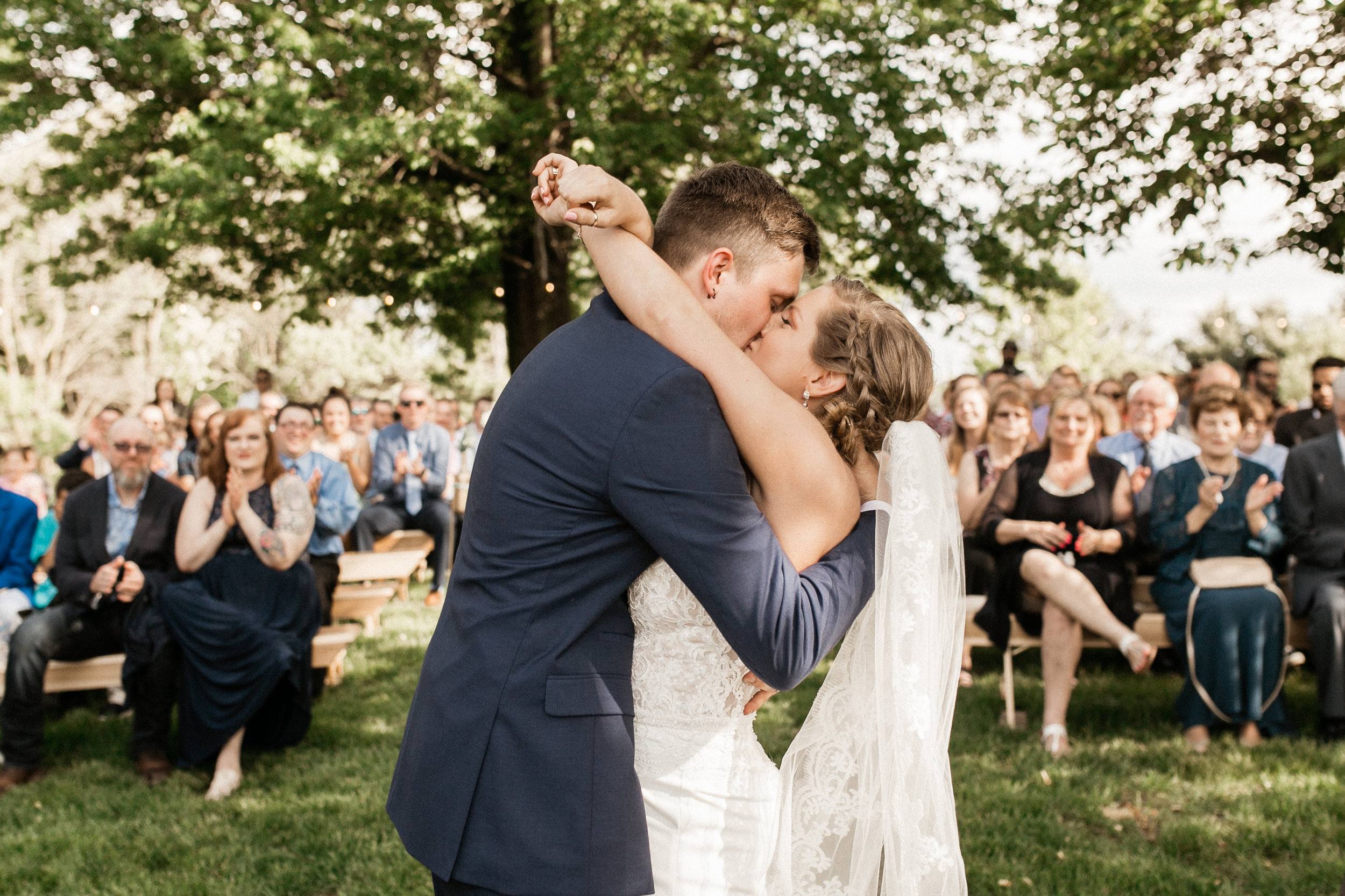 outdoor-indiana-wedding-ceremony-first-kiss