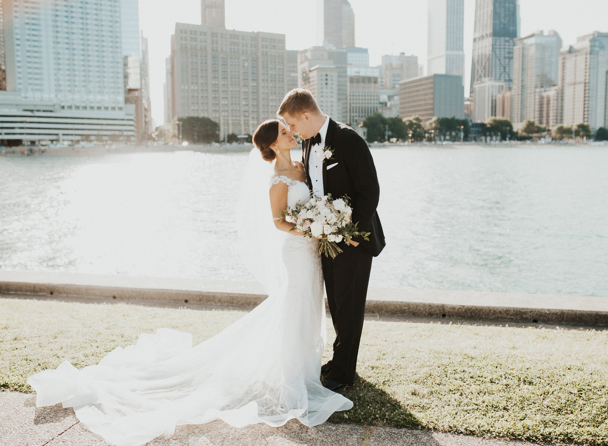 Classic and Fun Bride & Groom kissing in front of downtown Chicago Skyline