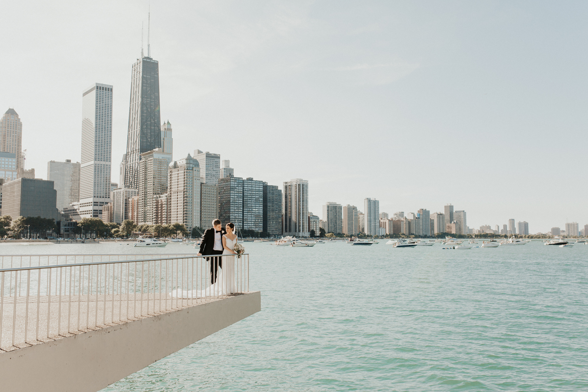 Bride & Groom in Downtown Chicago Skyline at Milton Olive Park with Wedding Photographer