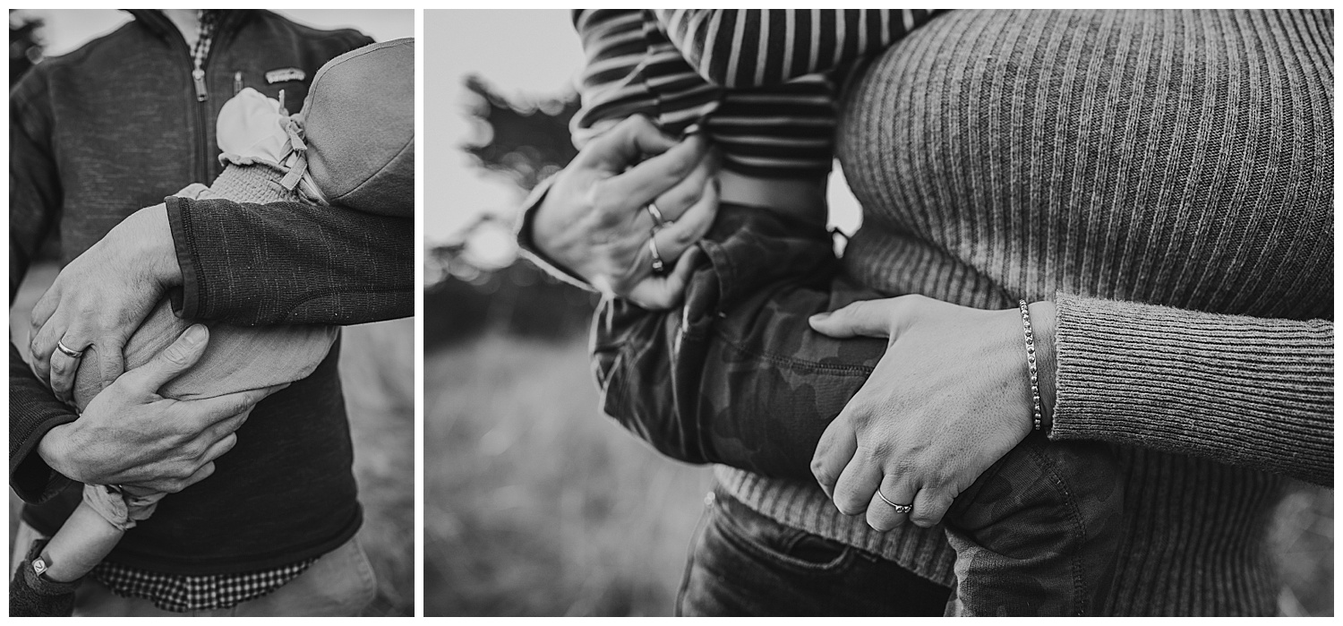 black and white images of dad and mom holding baby