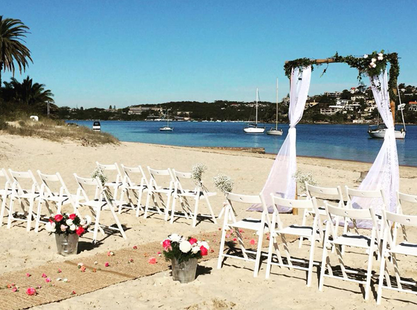A beautiful Beach Ceremony Set up by Waves & Weddings