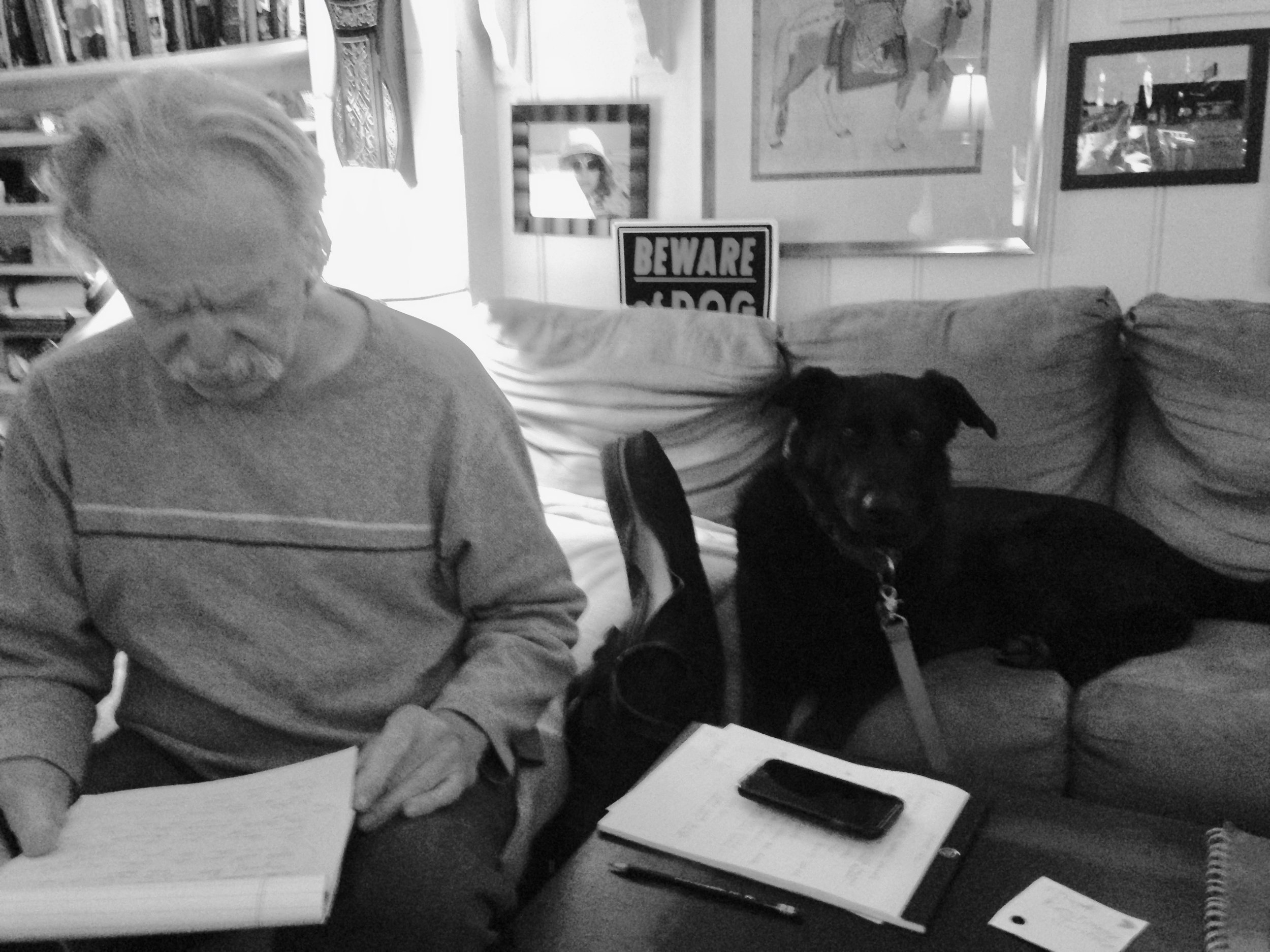 Vocalist Tommy Lepson working on lyrics with Daisy the Dog.