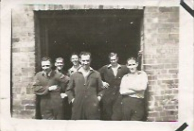 My Grandad (far right) and his workers outside the main doors when the building was his engineering factory.