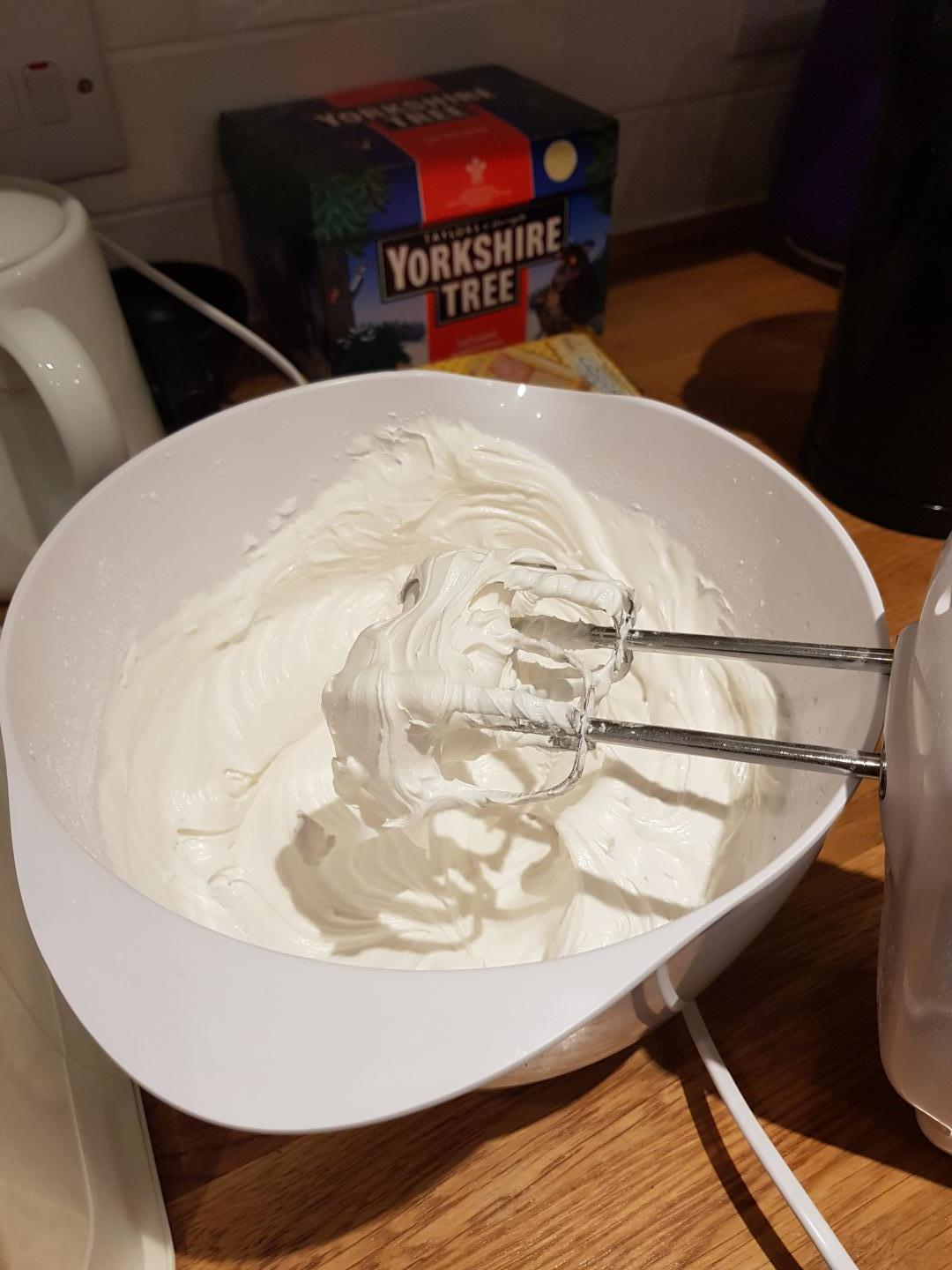 6. Whisk until stiff peaks start to to form and the icing appears glossy.
