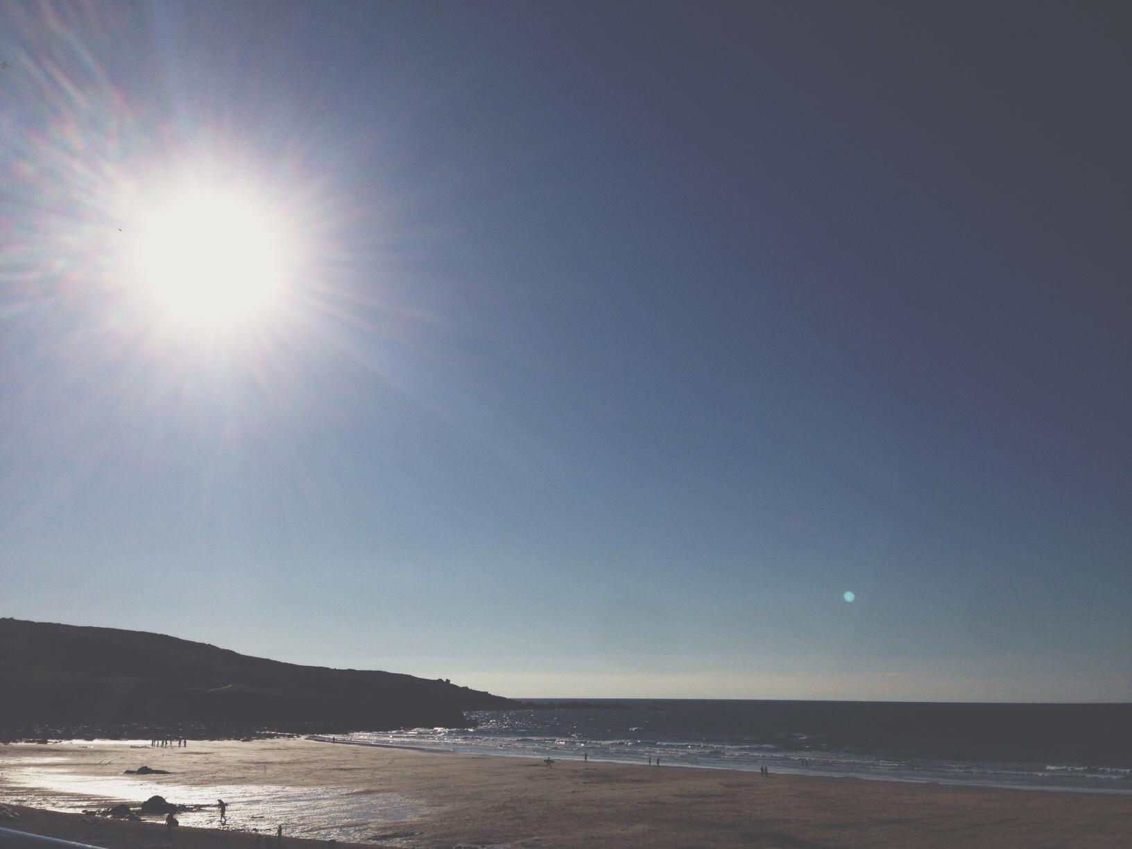 The watery yet warm sun over Porthmeor beach, St Ives