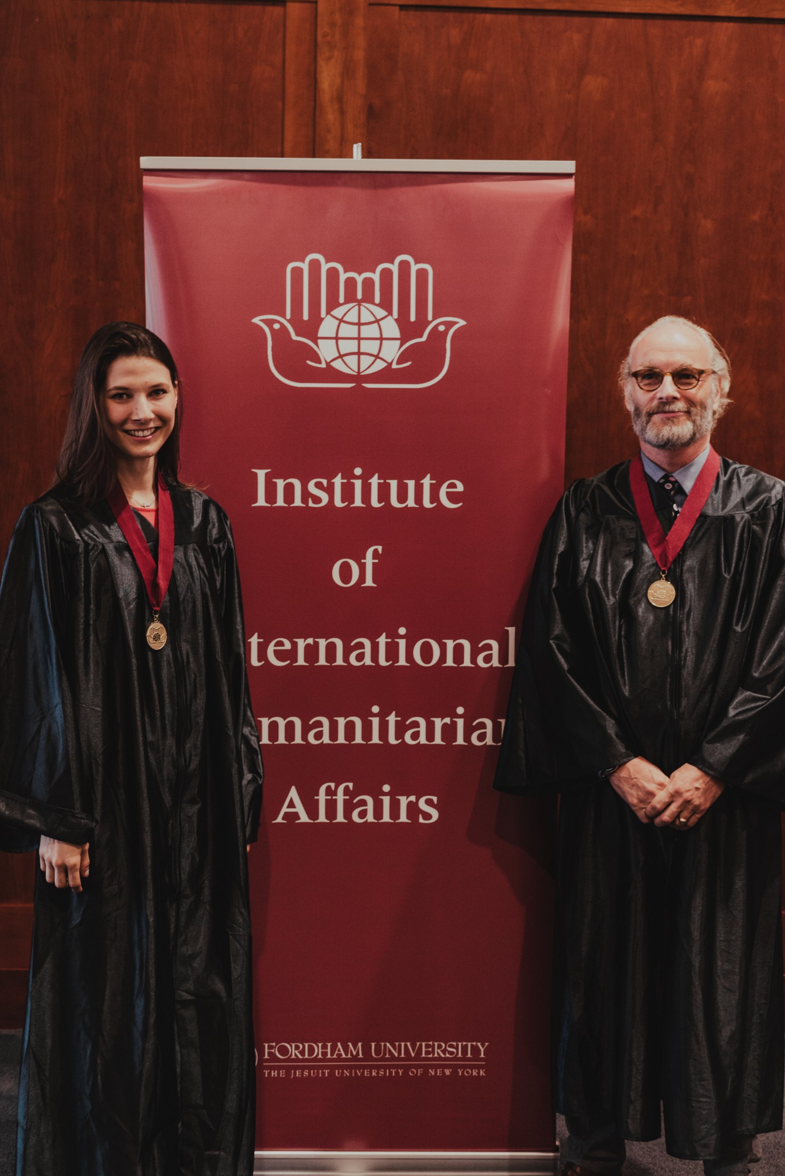 Peter Ophoff and Katarzyna Laskowski smiling after receiving their Master of Arts in International Humanitarian Action (MIHA).