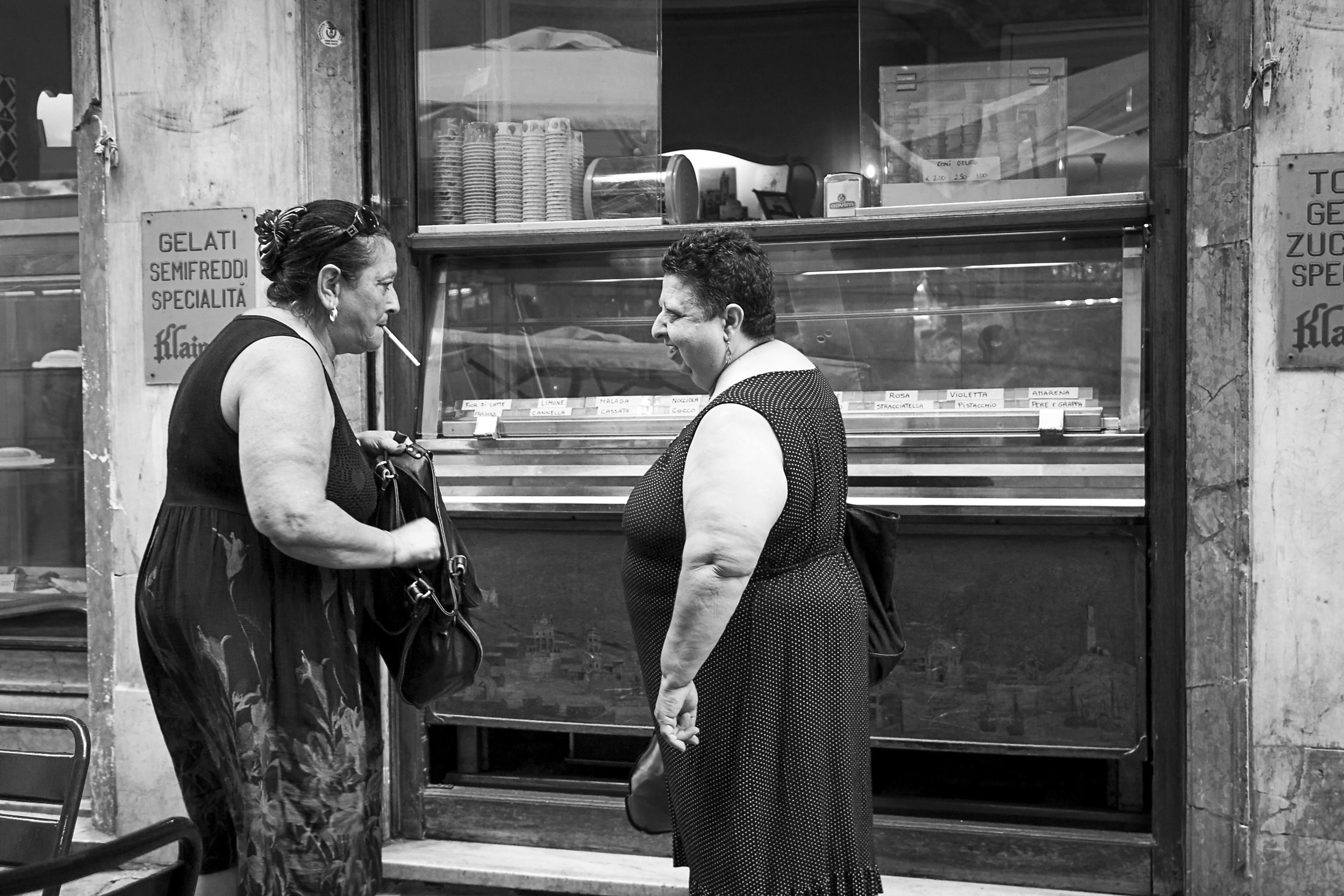 Some locals enjoy a smoke after their morning cafe.