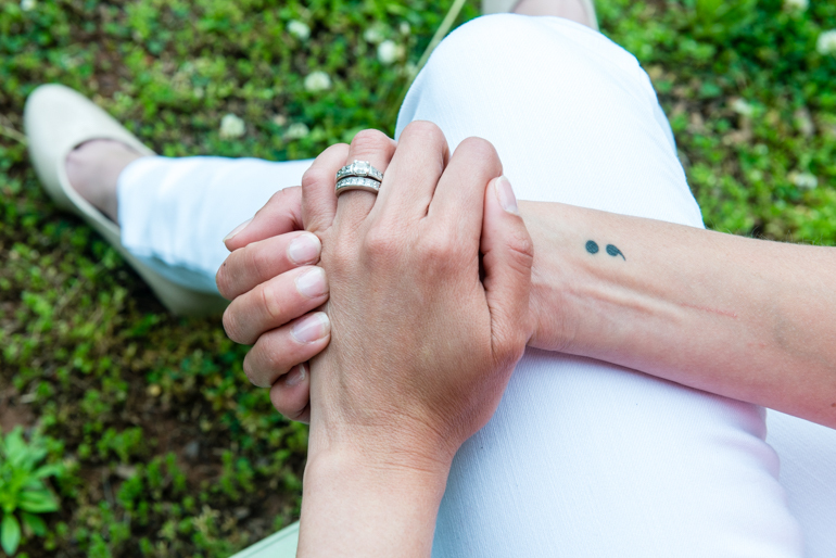 Powell has a semicolon tattoo on her right wrist. The tattoo refers to Project Semicolon, a nonprofit that aims to provide hope for those struggling with mental illness. (HEIDI DE MARCO / KHN)