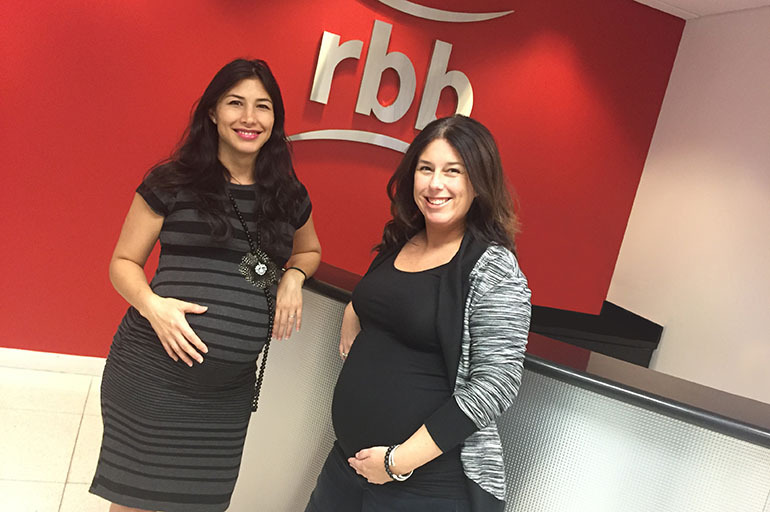 Mothers-to-be Zonnia Knight (left) and Susie Gilden, colleagues at rbb Communications in Coral Gables, Fla., say that Zika adds a new layer of anxiety to their pregnancies. (Courtesy  rbb Communications )