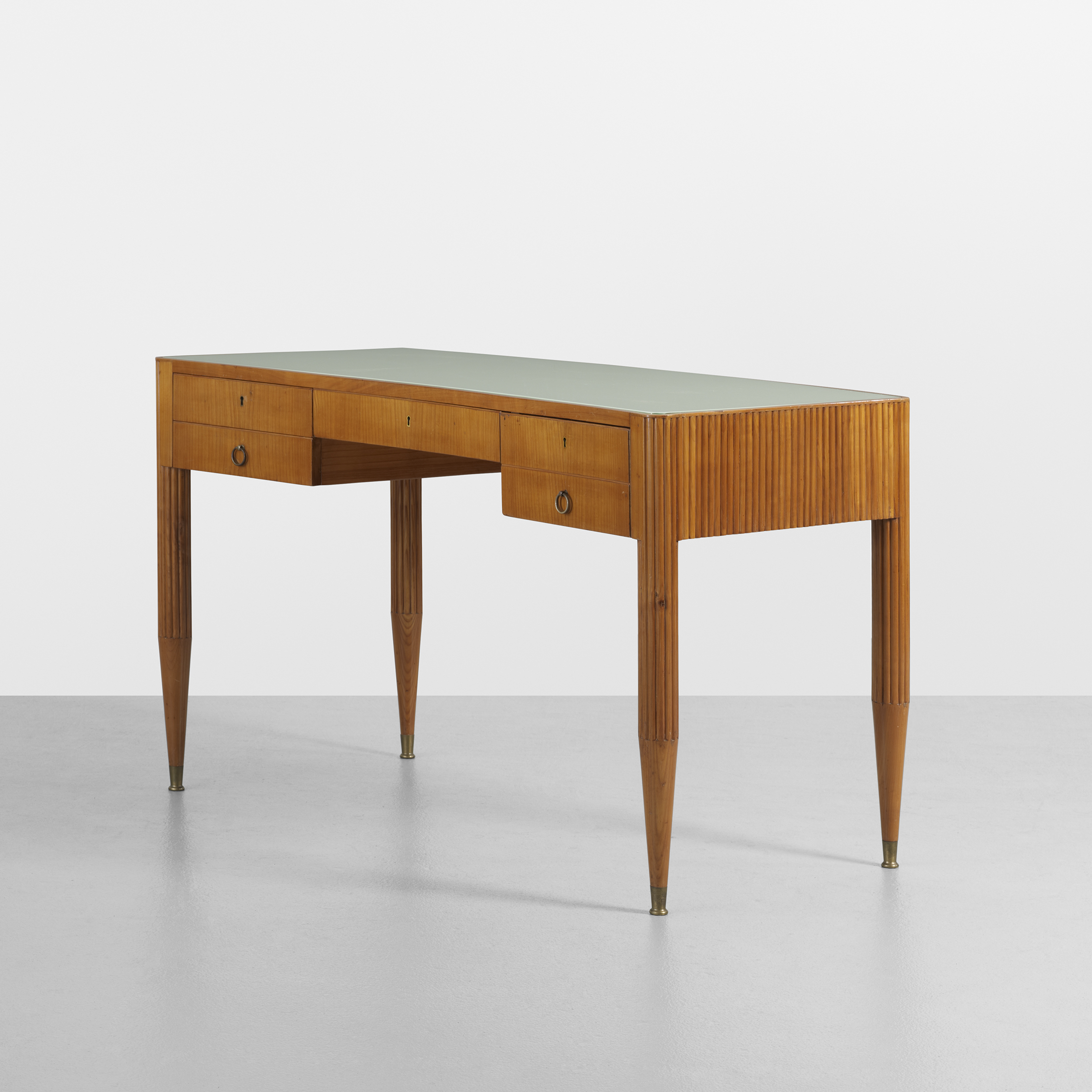 Giò Ponti (Italian, 1891–1979) Desk, 1938 Fruitwood, reverse-painted glass, and brass 31 x 53 x 26 1/2 inches Private collection