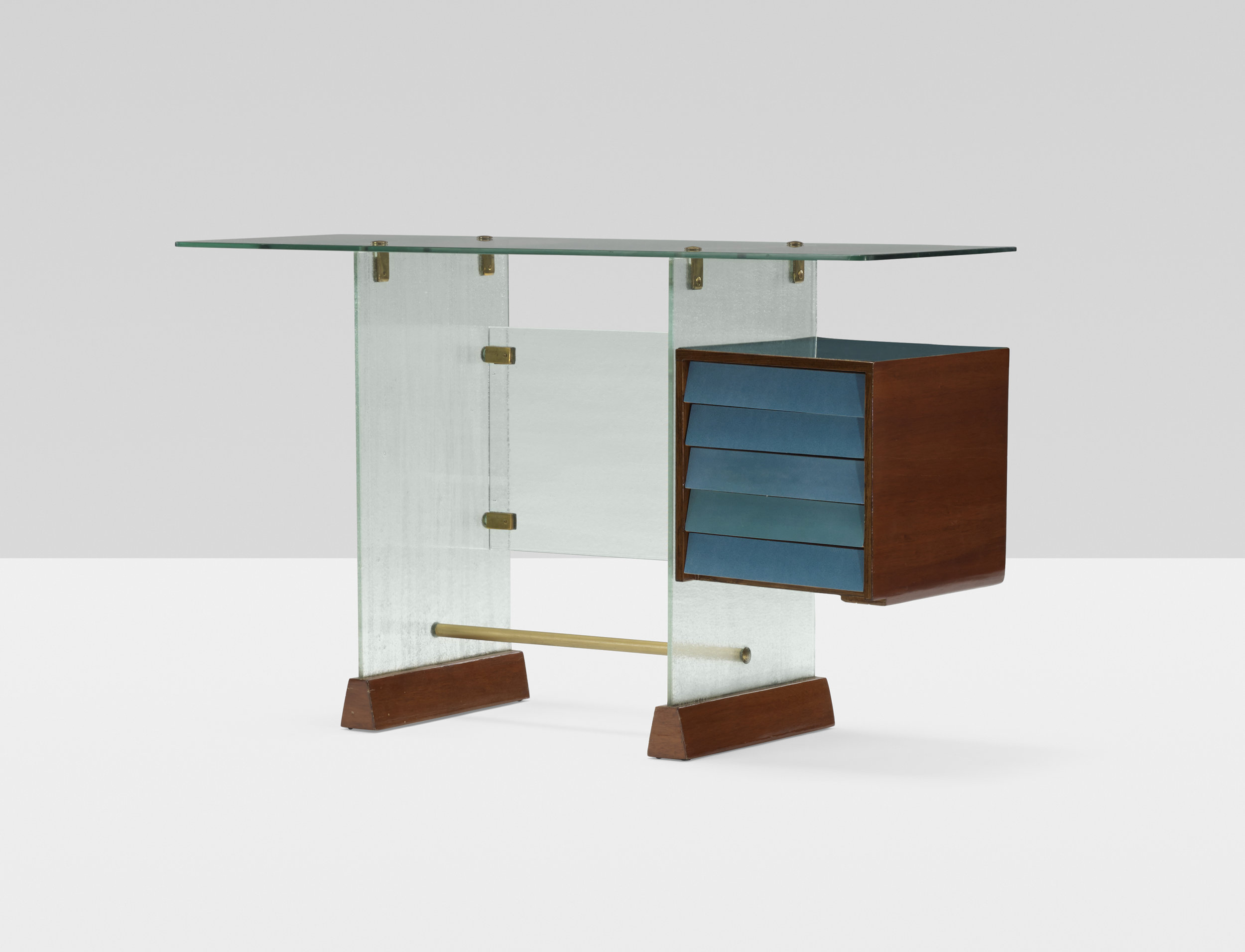Giò Ponti (Italian, 1891–1979) Desk from the Societa Vetrocoke Building, Milan, ca. 1939 Vitrex glass, laminate, Italian walnut, enameled steel and brass