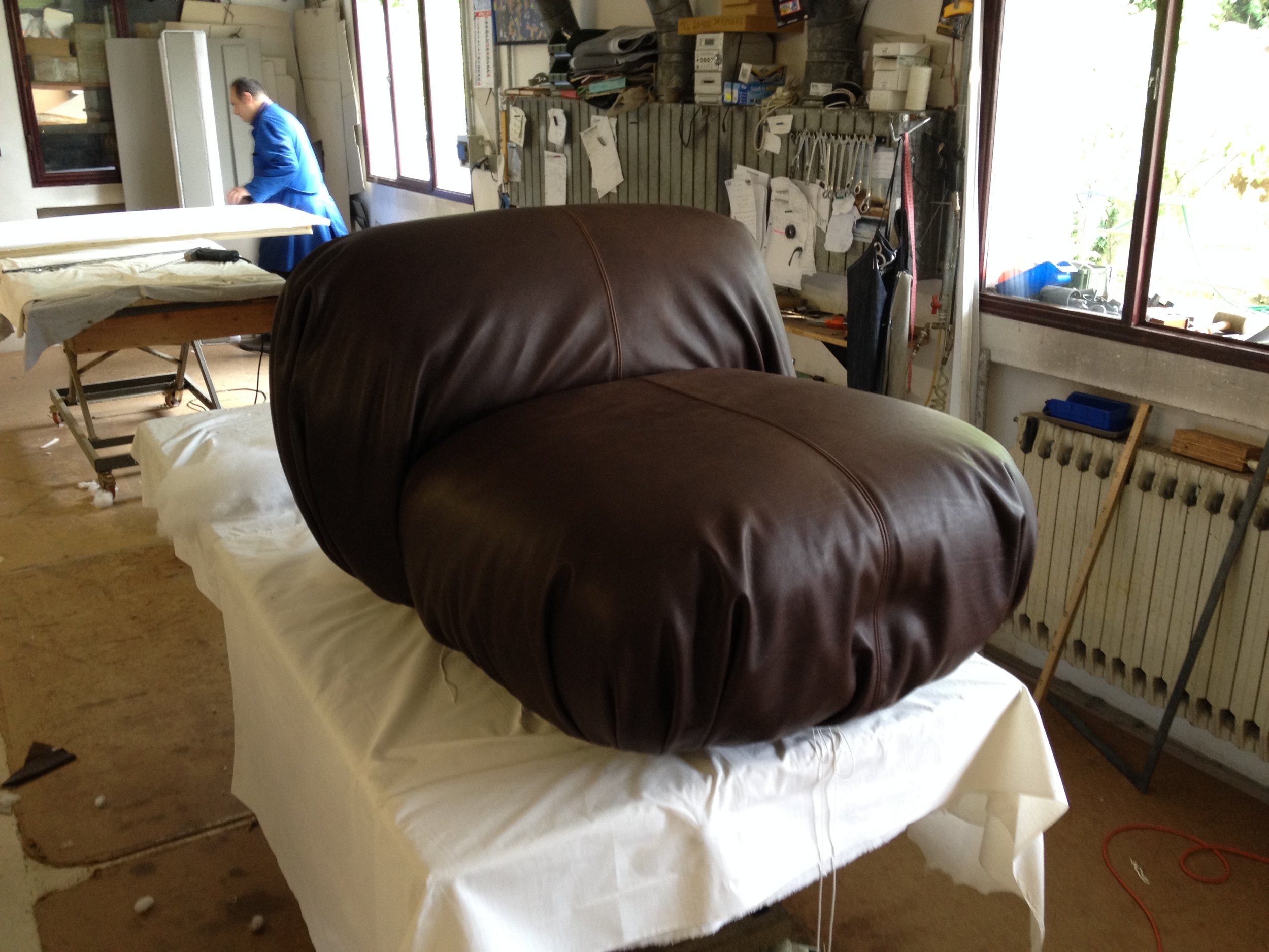 The leather is put in place now it's time to carefully recreating all of those lovely folds