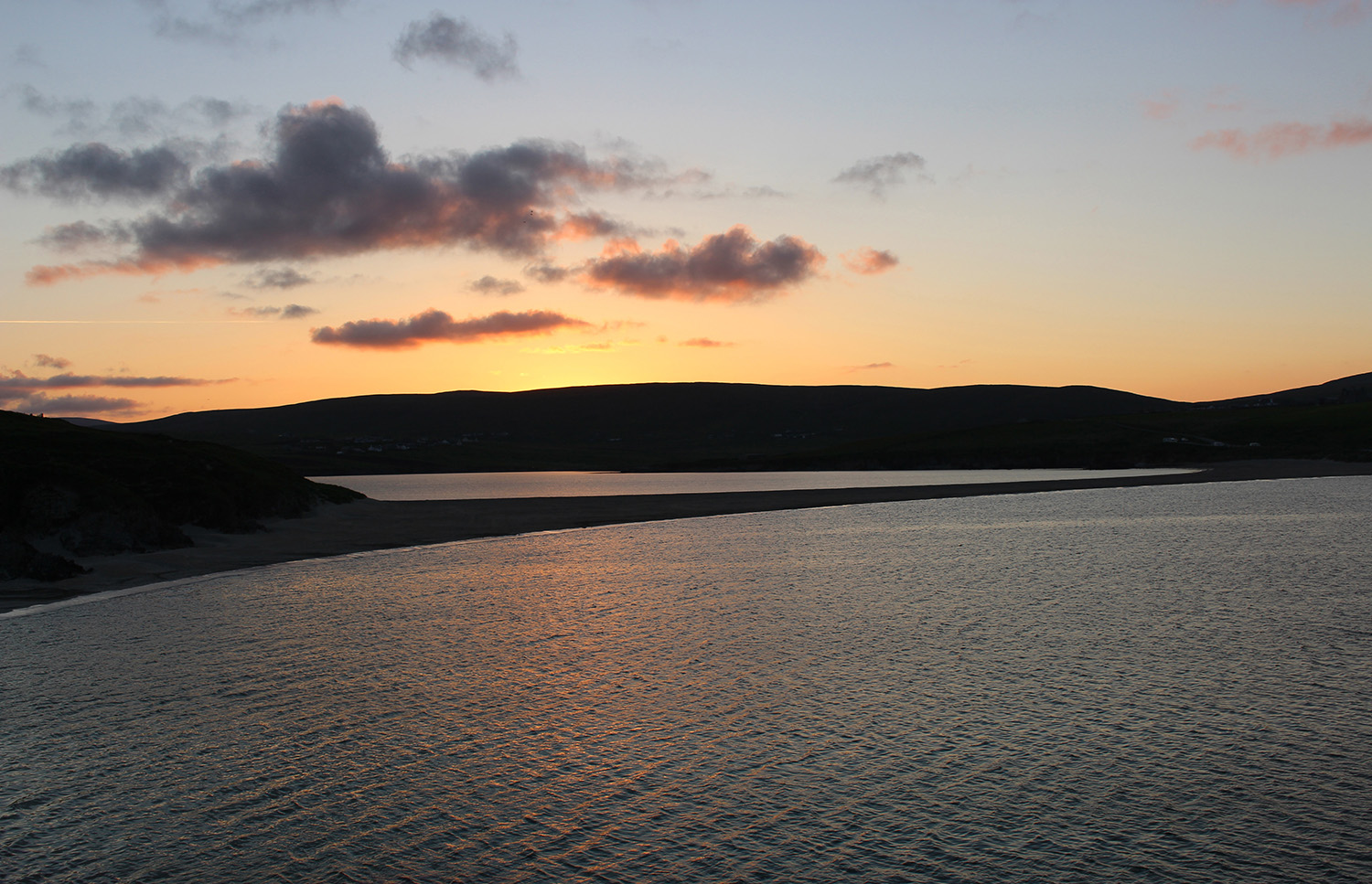 Looking back to the mainland from the East side of St Ninian's Isle with the sun beginning to rise.