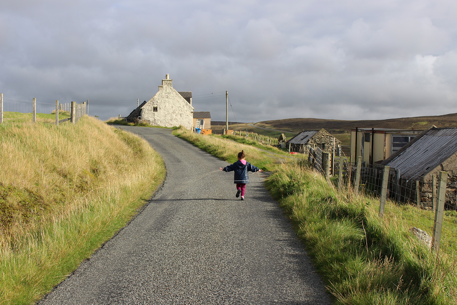 Love this photo of my niece! She loves being at the 'holiday hoose'. On our way up the road to the beach.