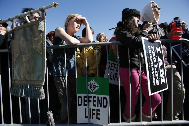 A group of pro-life demonstrators hold signs outside City Hall during the Ninth Annual Walk for Life West Coast rally in San Francisco, California, January 26, 2013. REUTERS/Stephen Lam