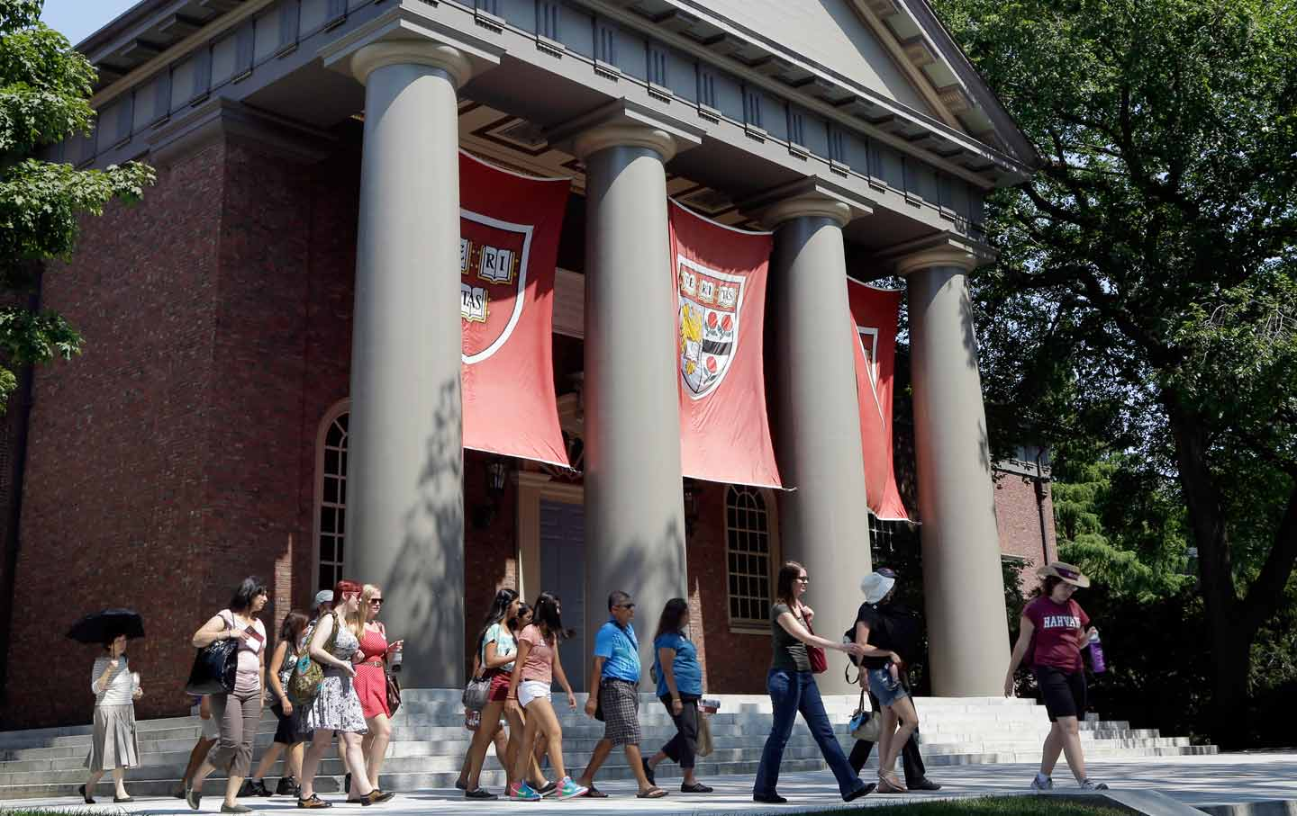 A tour group visits the campus of Harvard University in Cambridge, Massachusetts. (AP Photo / Elise Amendola, File)